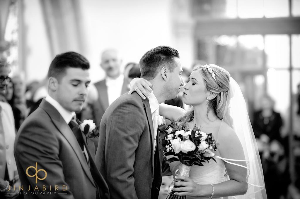 bride-kissing-groomr-st-marys-church-north-stifford