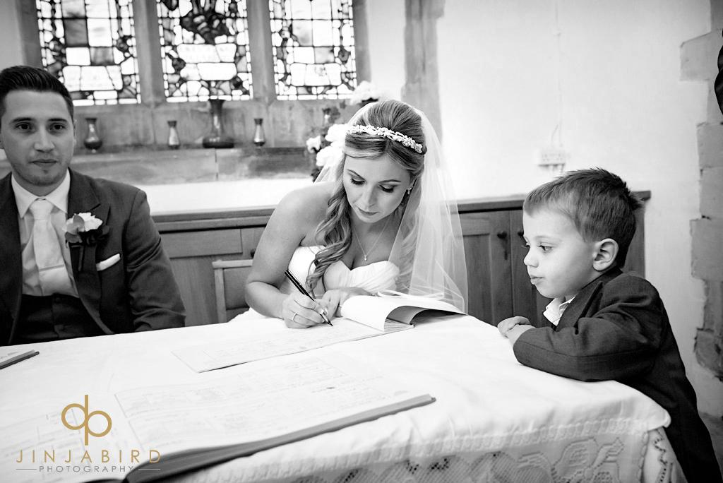 bride-signing-register-st-marys-church-north-stifford