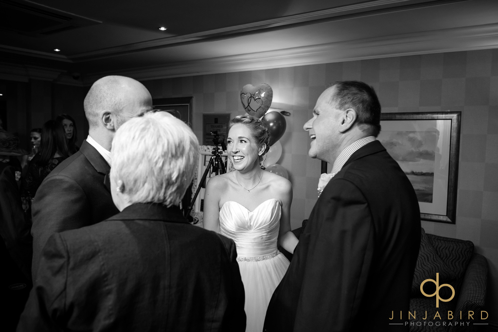 bride-with-family-bull-hotel-gerrards-cross