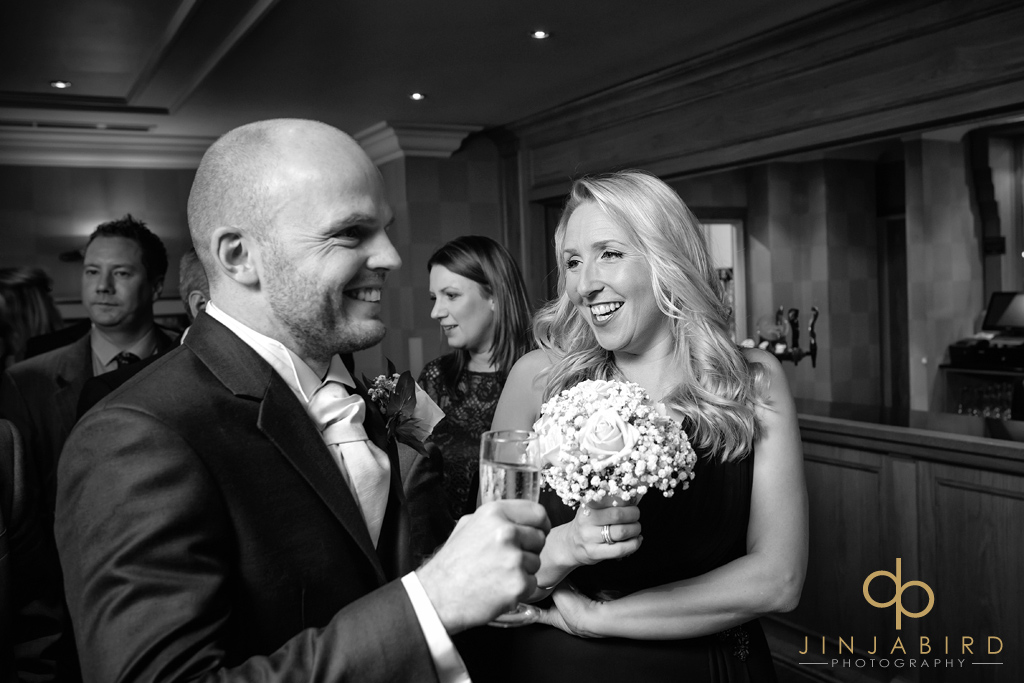 groom-with-bridesmaid-bull-hotel-gerrards-cross