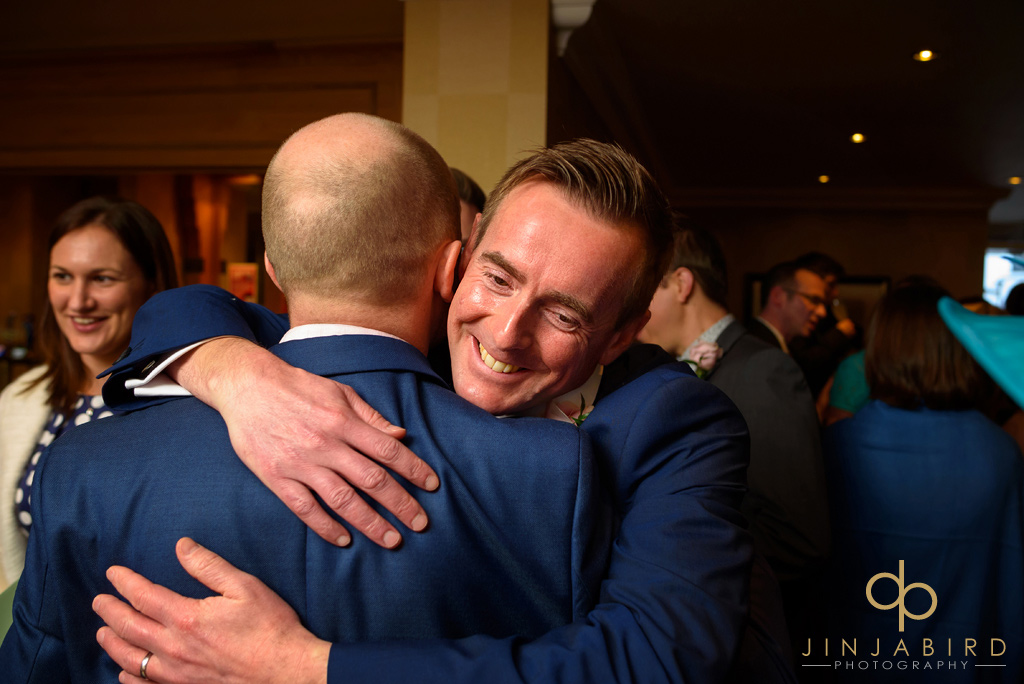 hugging-groom-photos-bull-hotel-gerrards-cross