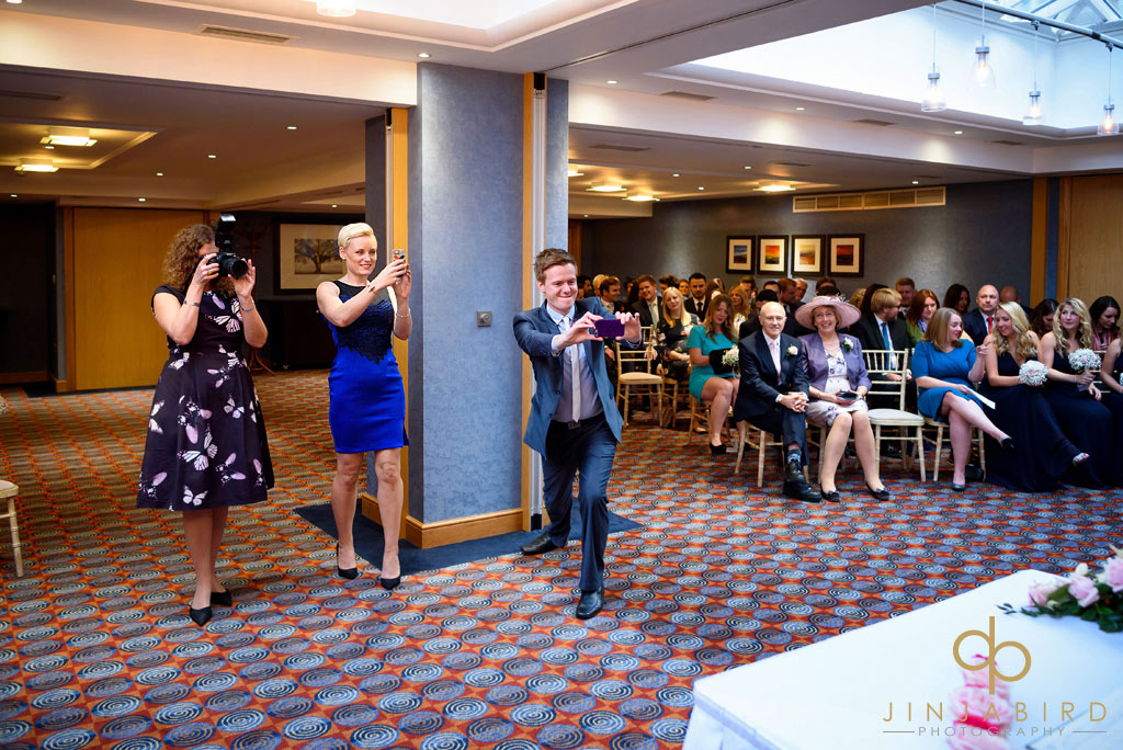 wedding-guests-taking-photos-bull-hotel-gerrards-cross