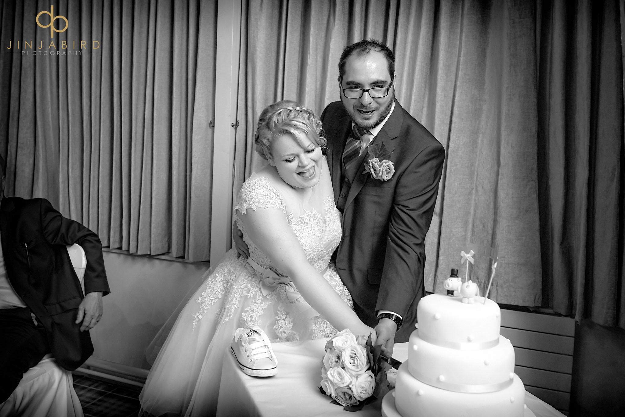 cutting wedding cake woburn safari lodge