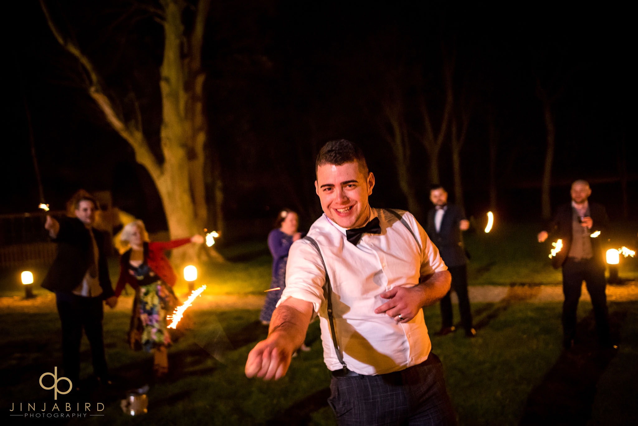 groom with sparklers normanton park hotel