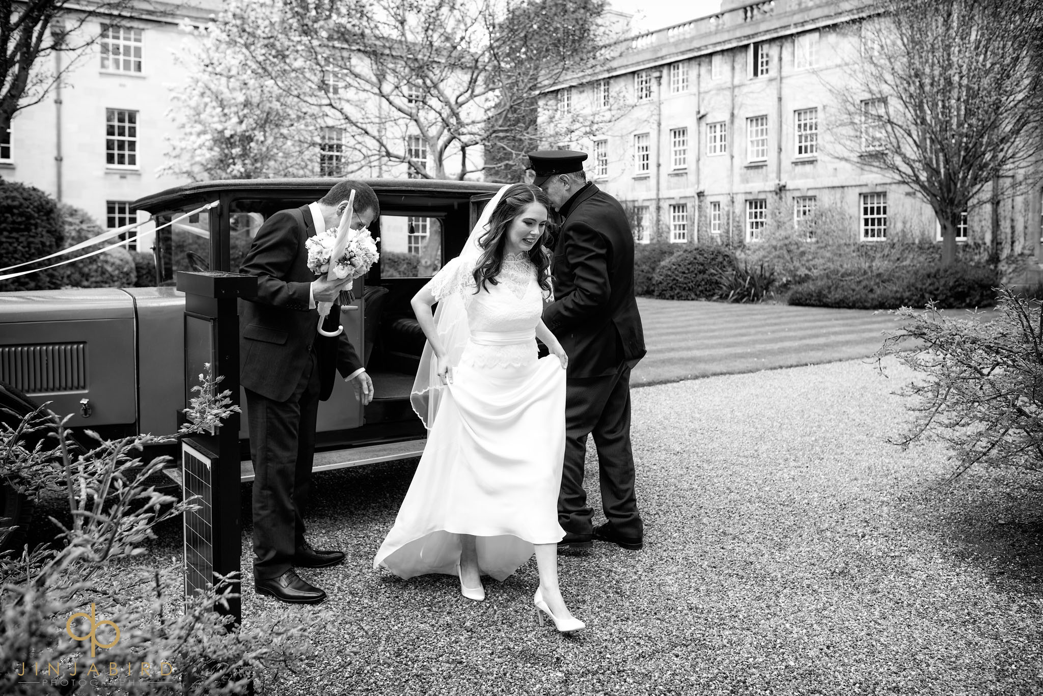 bride getting out of car downing college