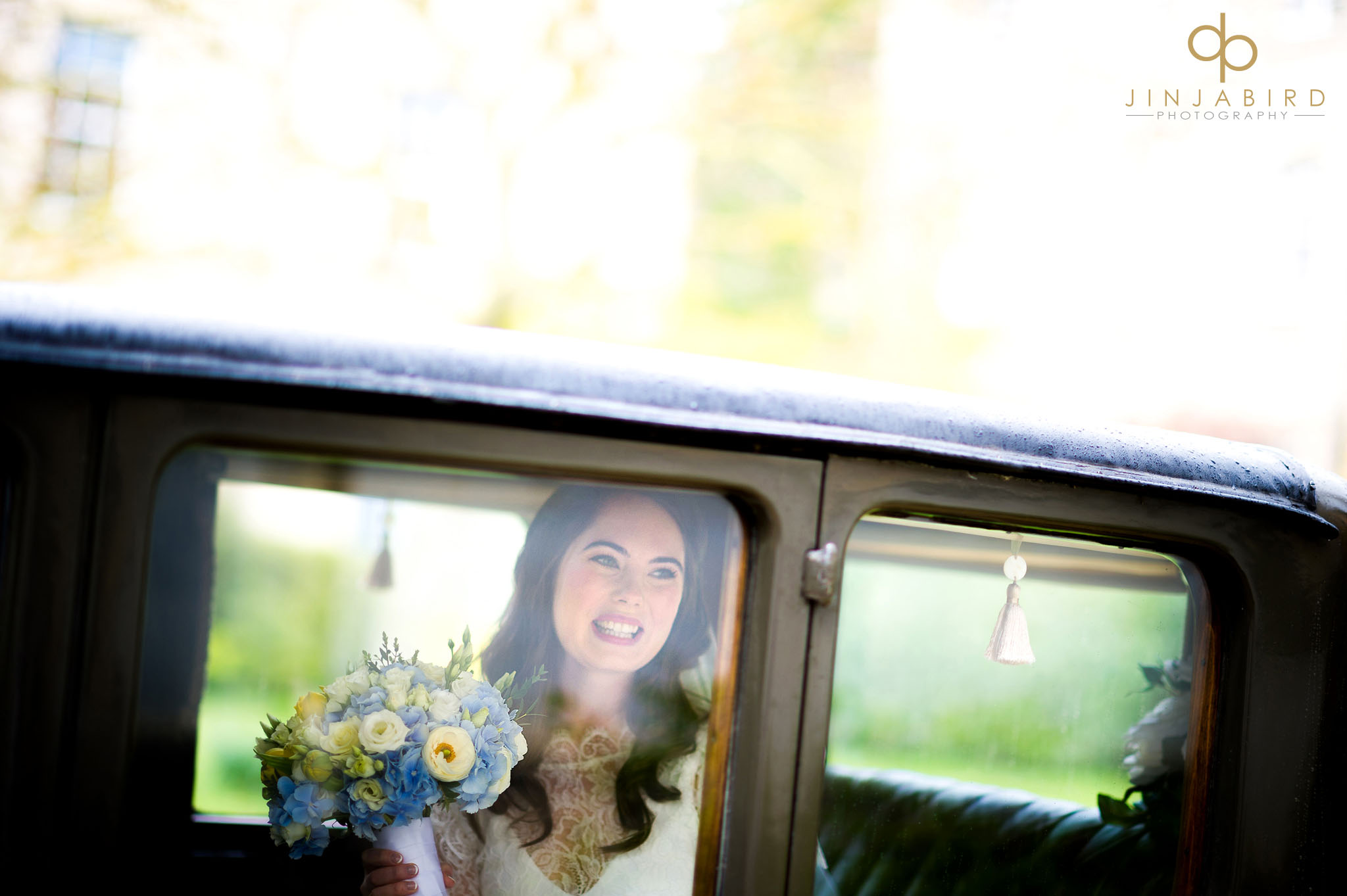 bride in wedding car downing college