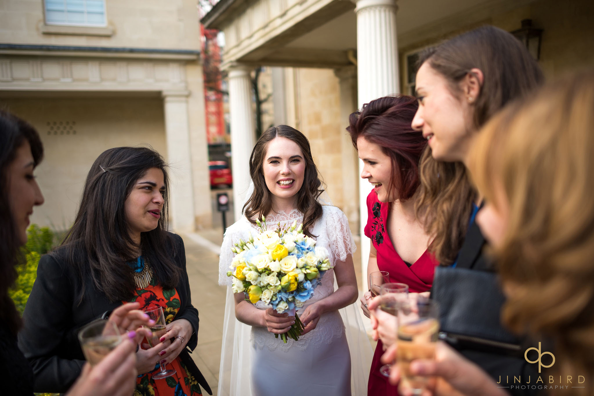 bride with friends downing college cambridge