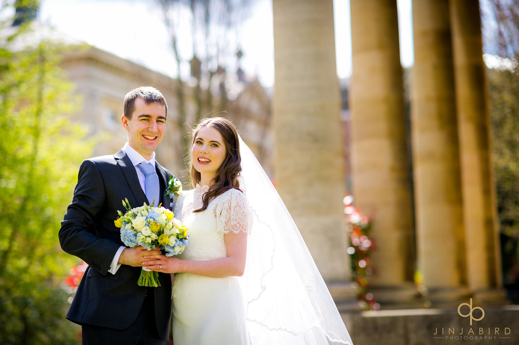 bride with groom downing college wedding