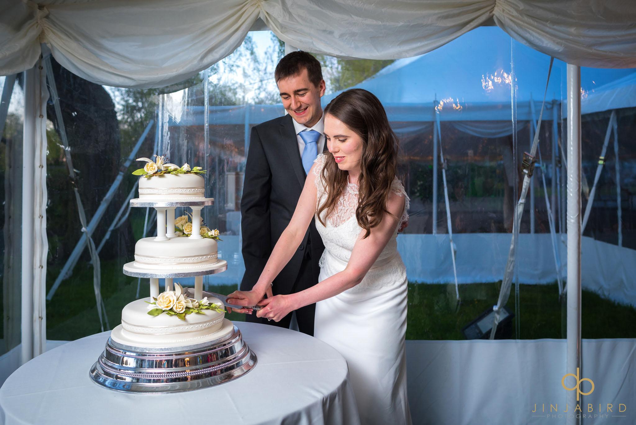 rectory farm cutting wedding cake