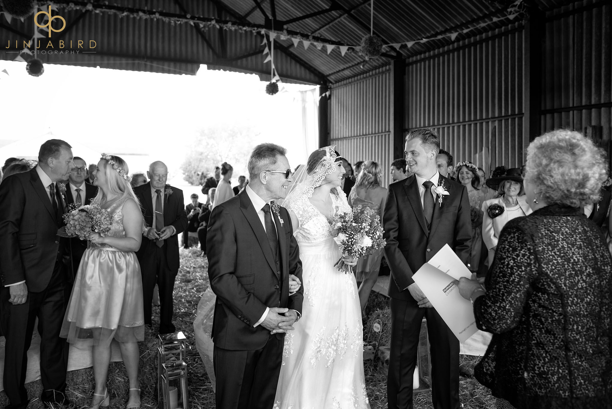 bride groom in haybarn