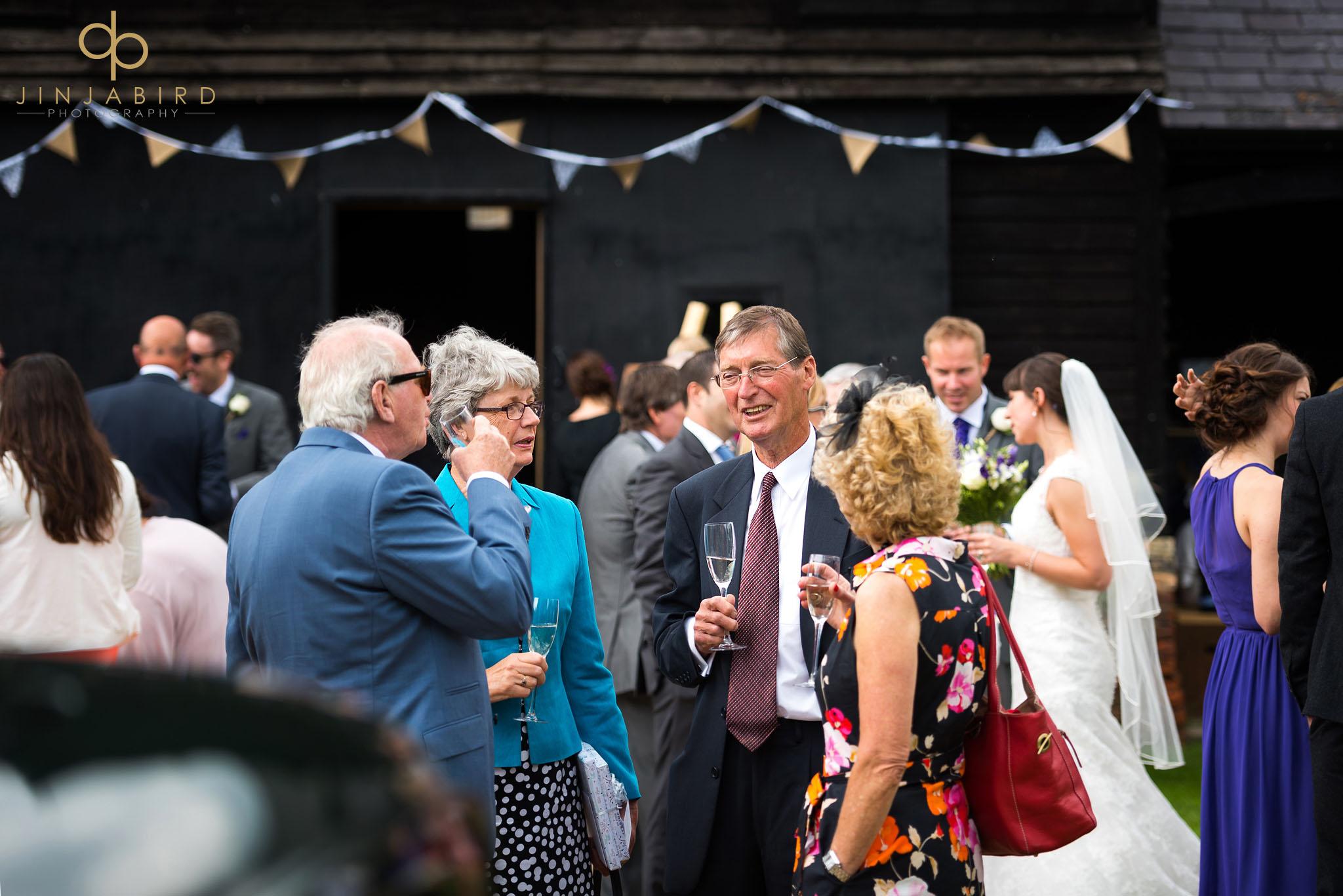 wedding guests drinking childerley hall