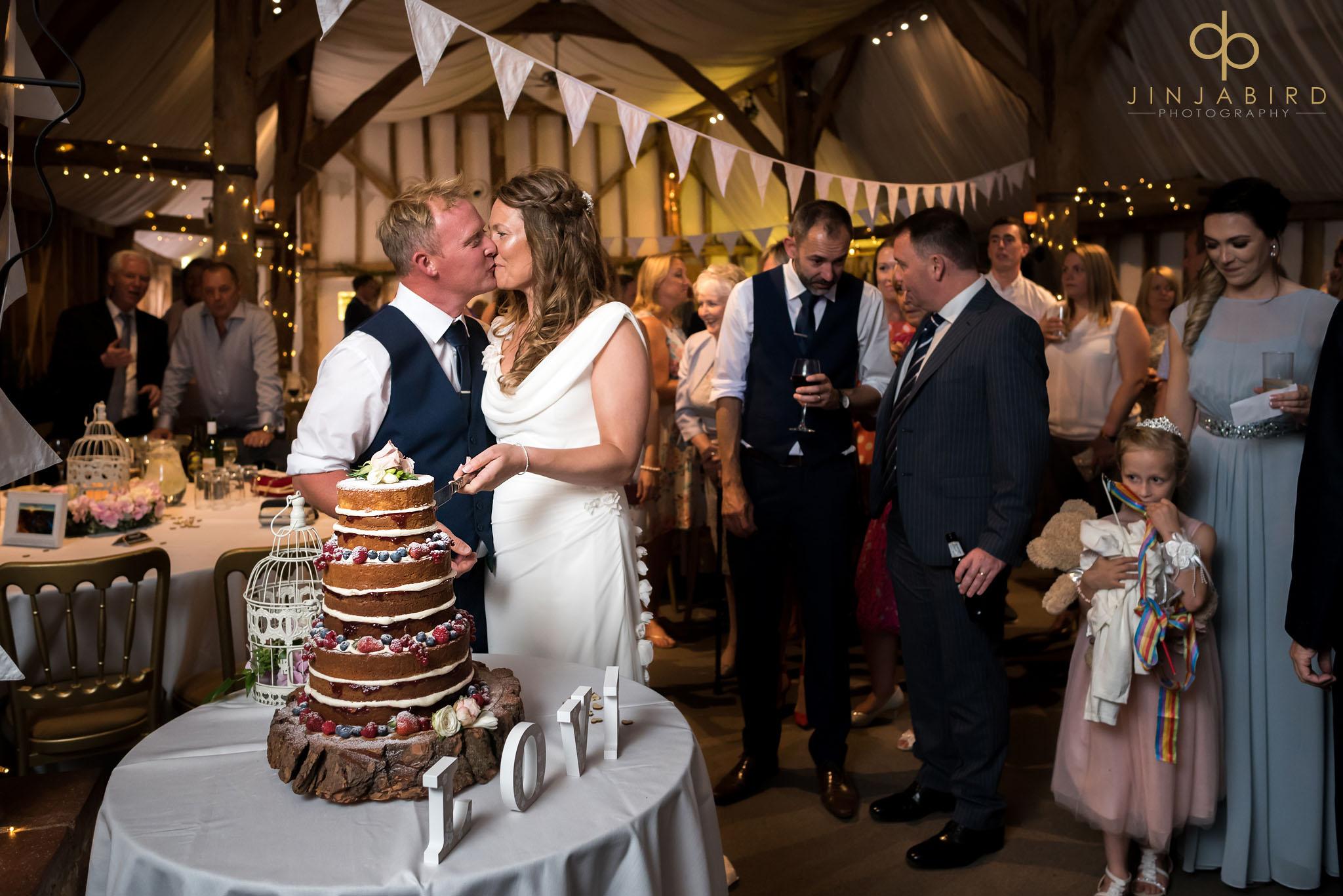 cutting wedding cake south farm