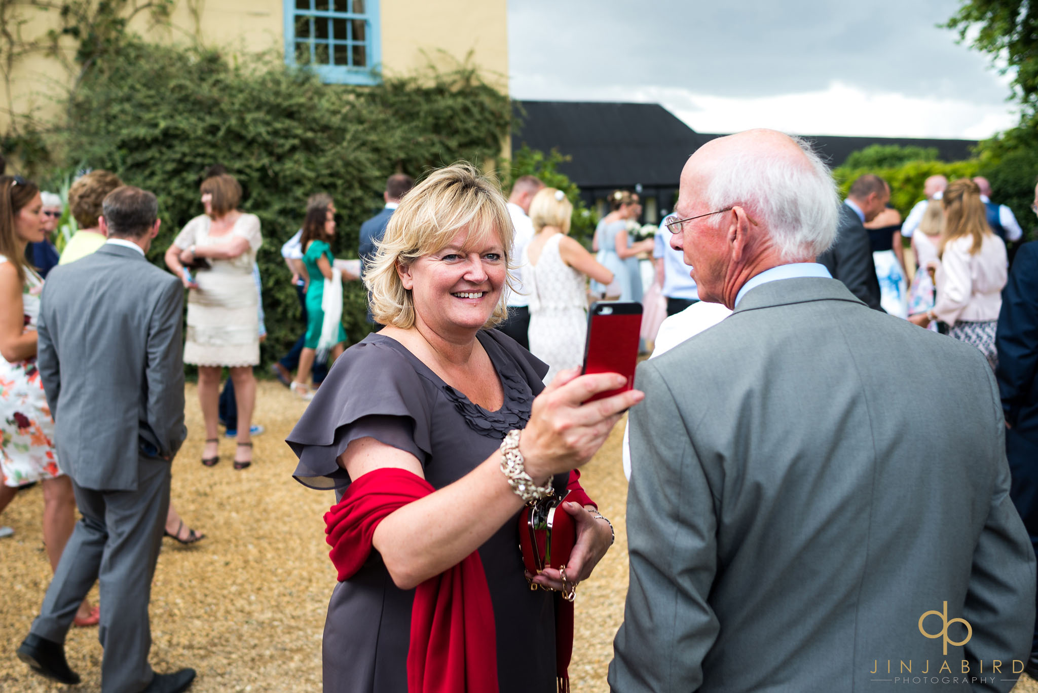 wedding guest photographing