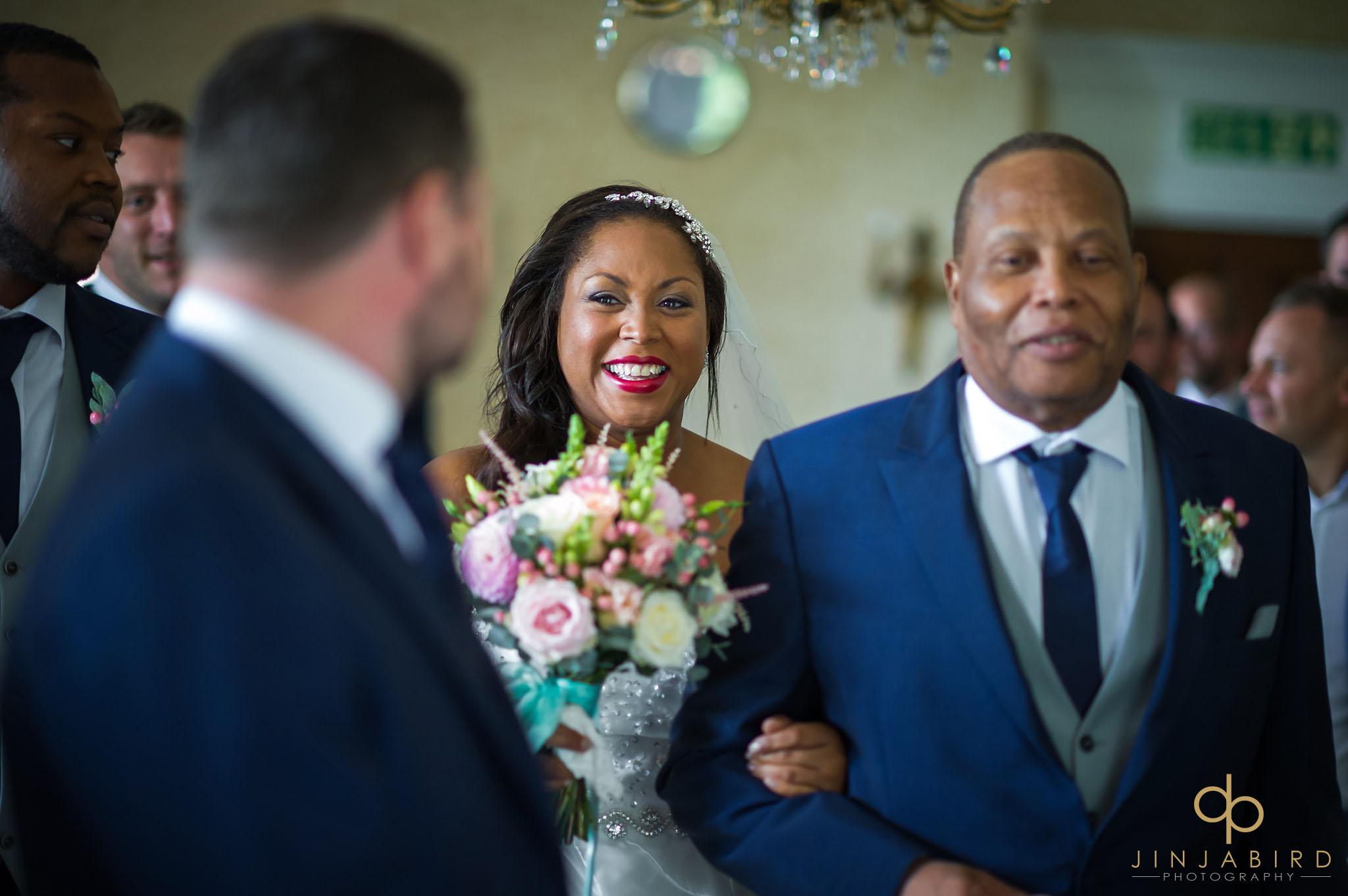 bride-coming-down-aisle-highgate-house