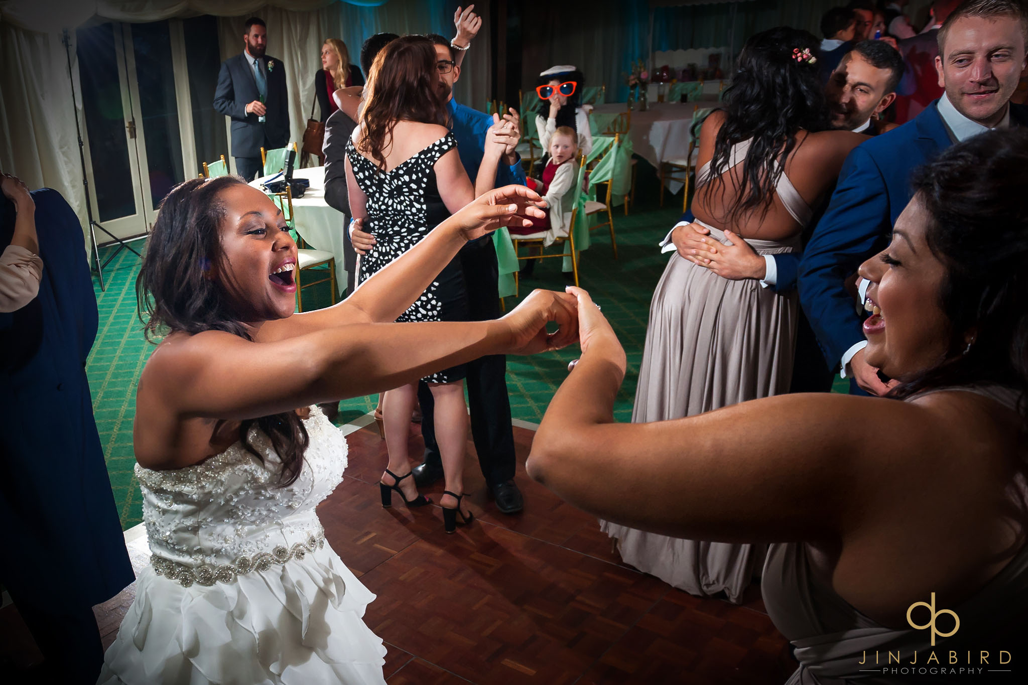 bride-dancing-with-sister-highgate-house