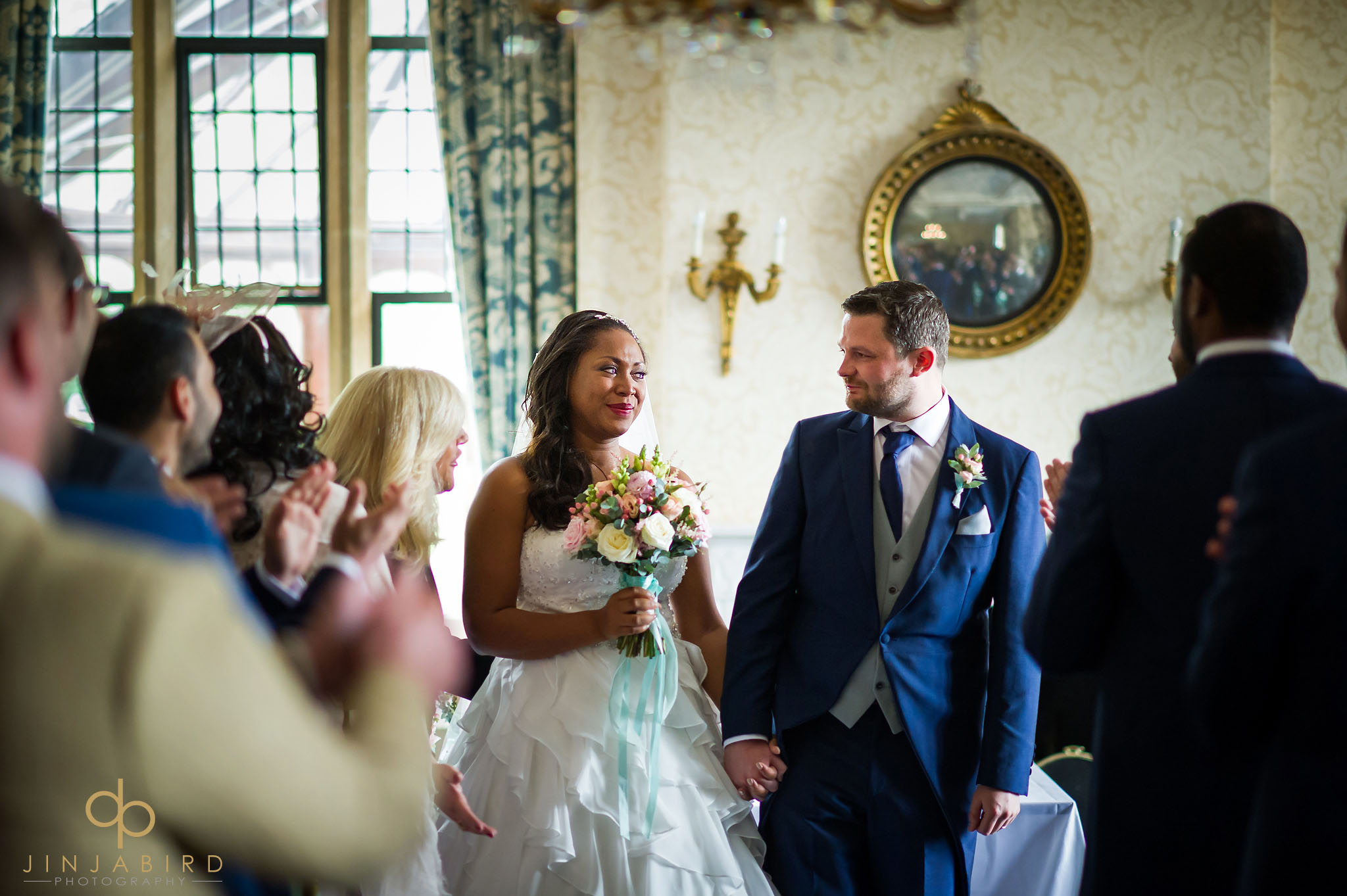 bride-with-groom-coming-down-aisle-highgate-house