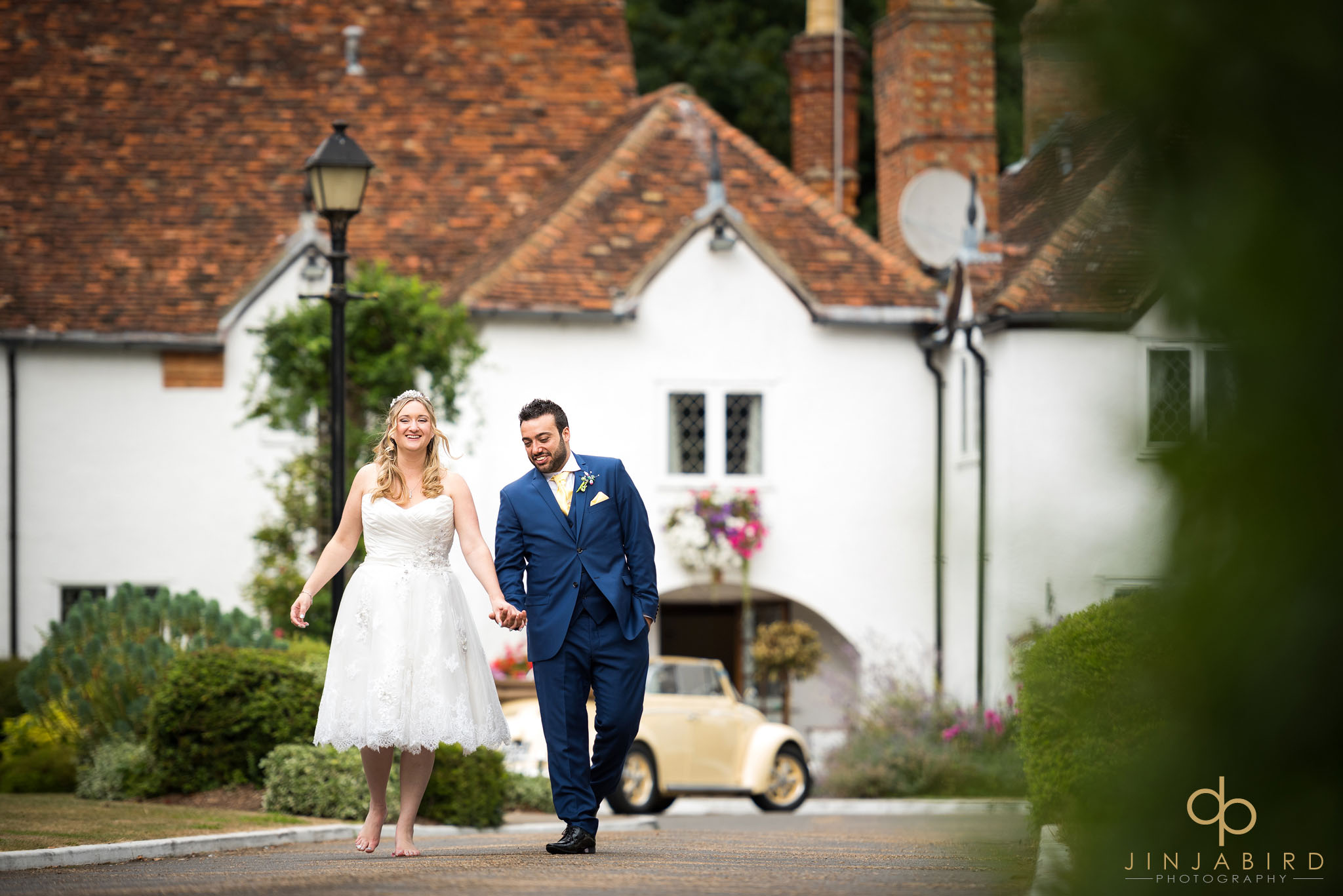 bride-with-groom-outside-barns-hotel