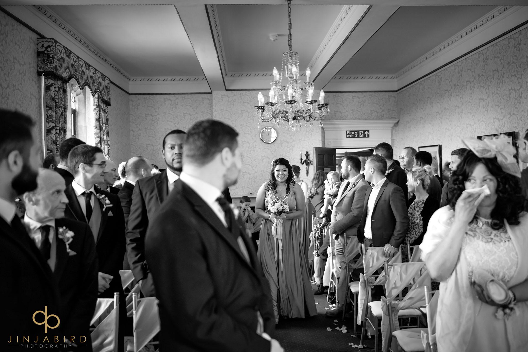 bridesmaids-coming-down-aisle
