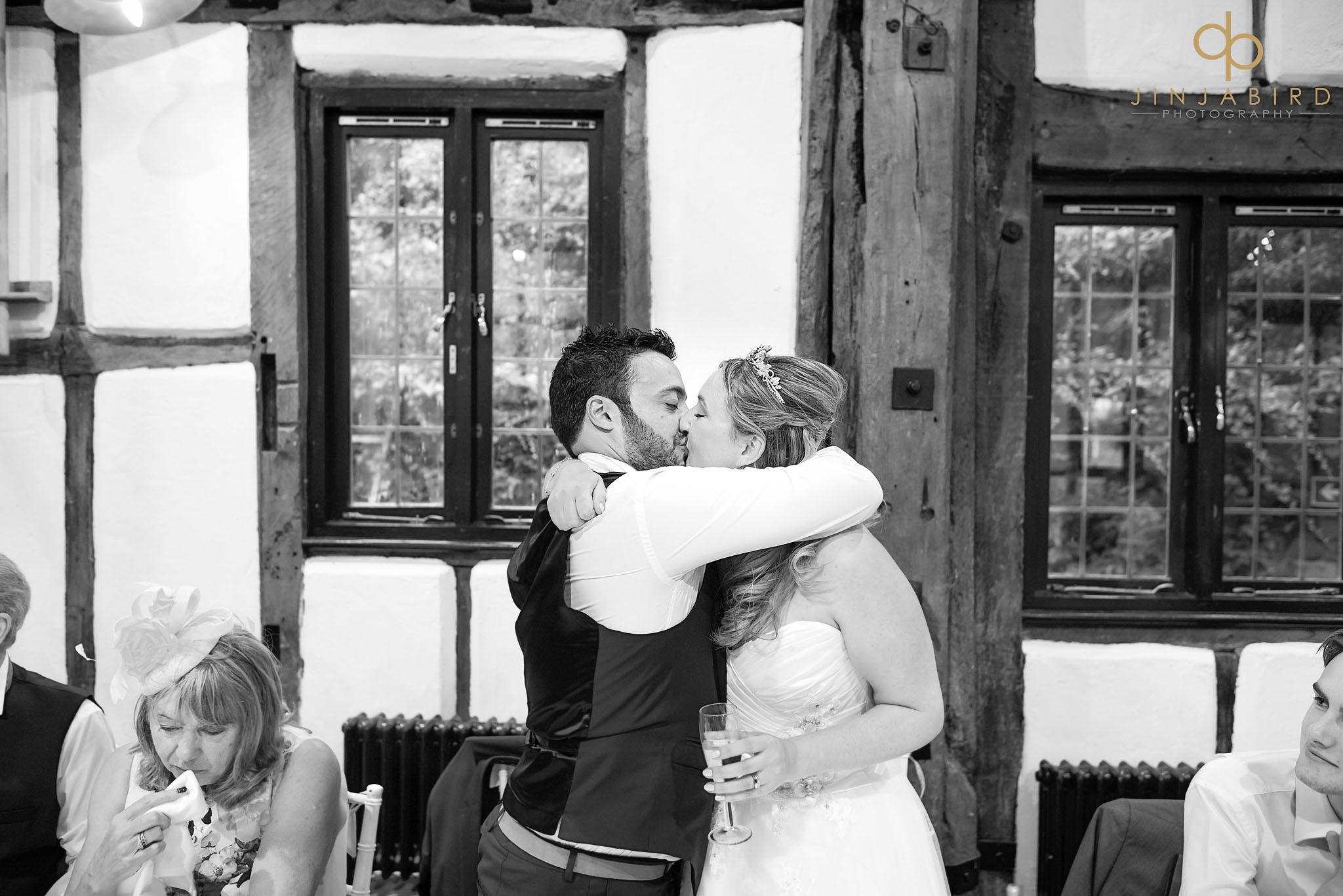 groom-kissing-bride-barns-hotel