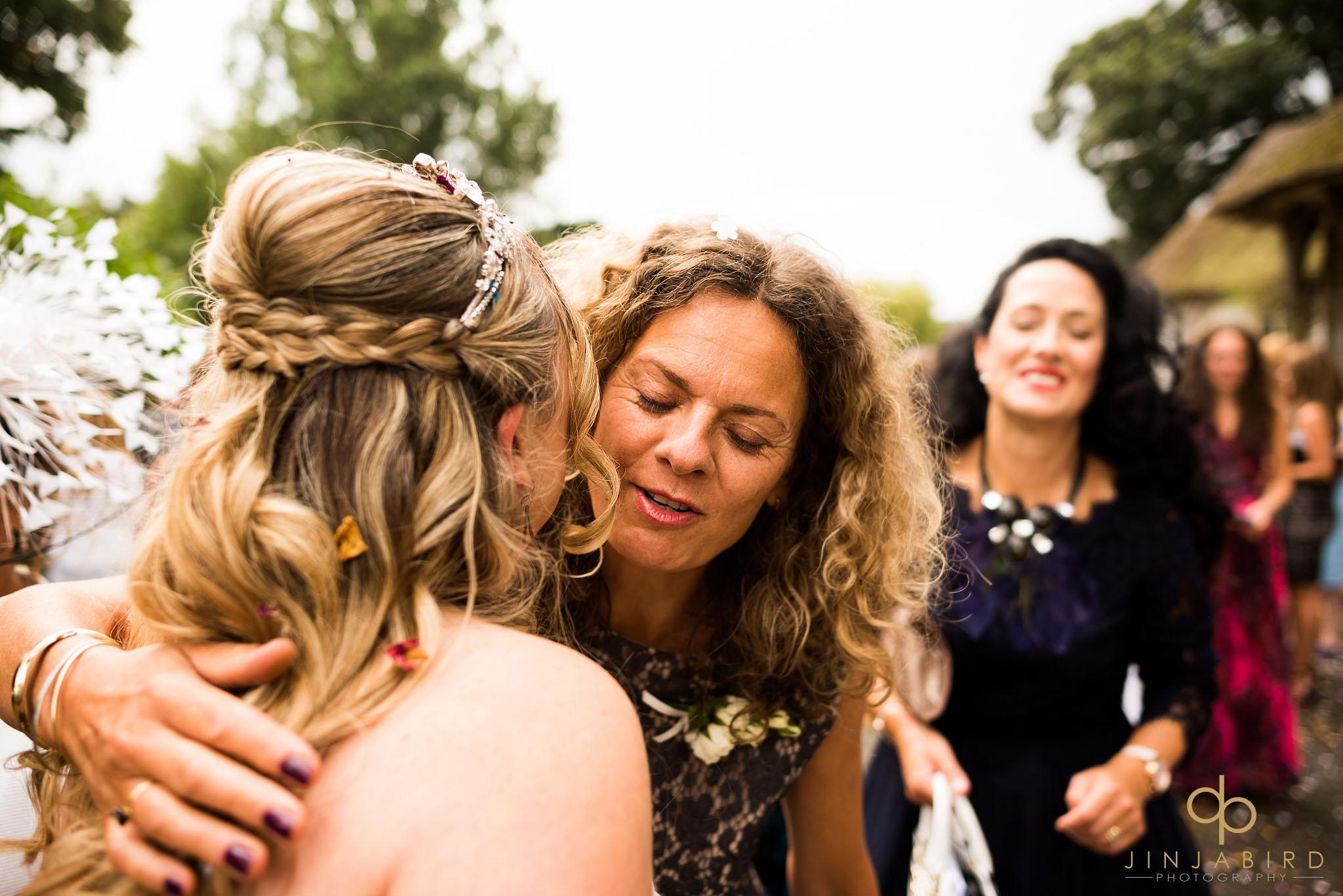 wedding-guest-hugging-bride