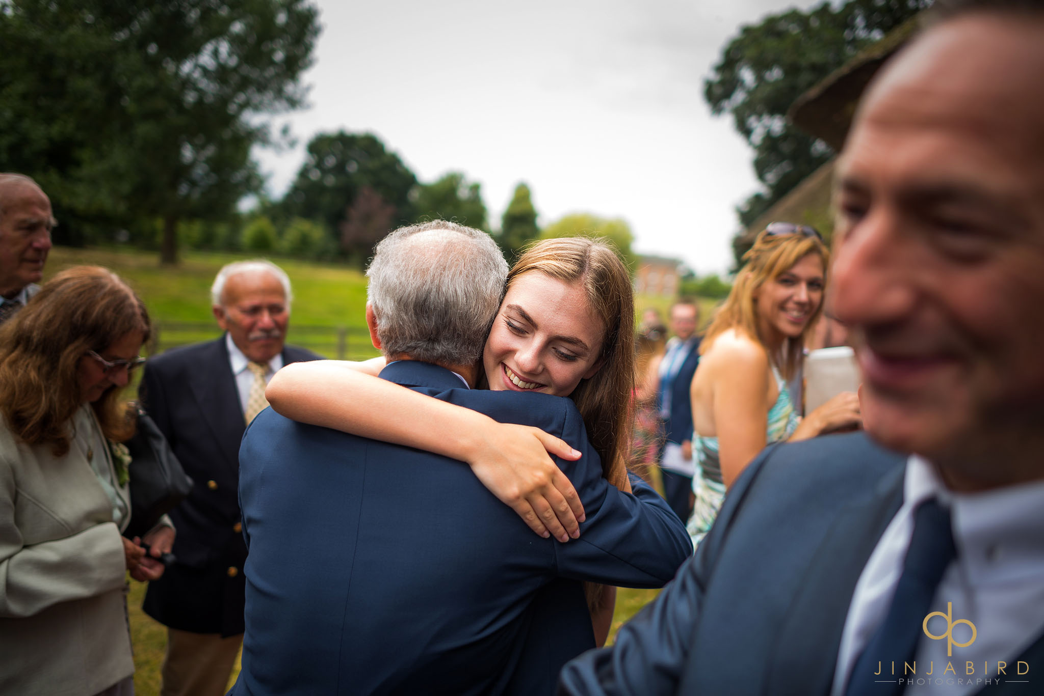 wedding-guest-hugging-father