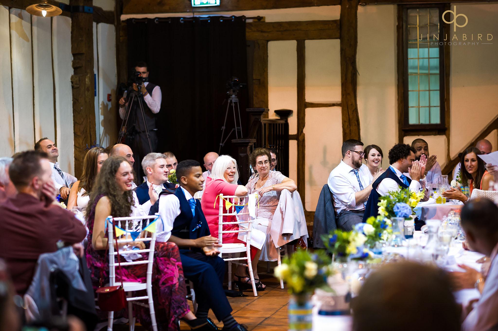 wedding-guest-listening-to-speeches