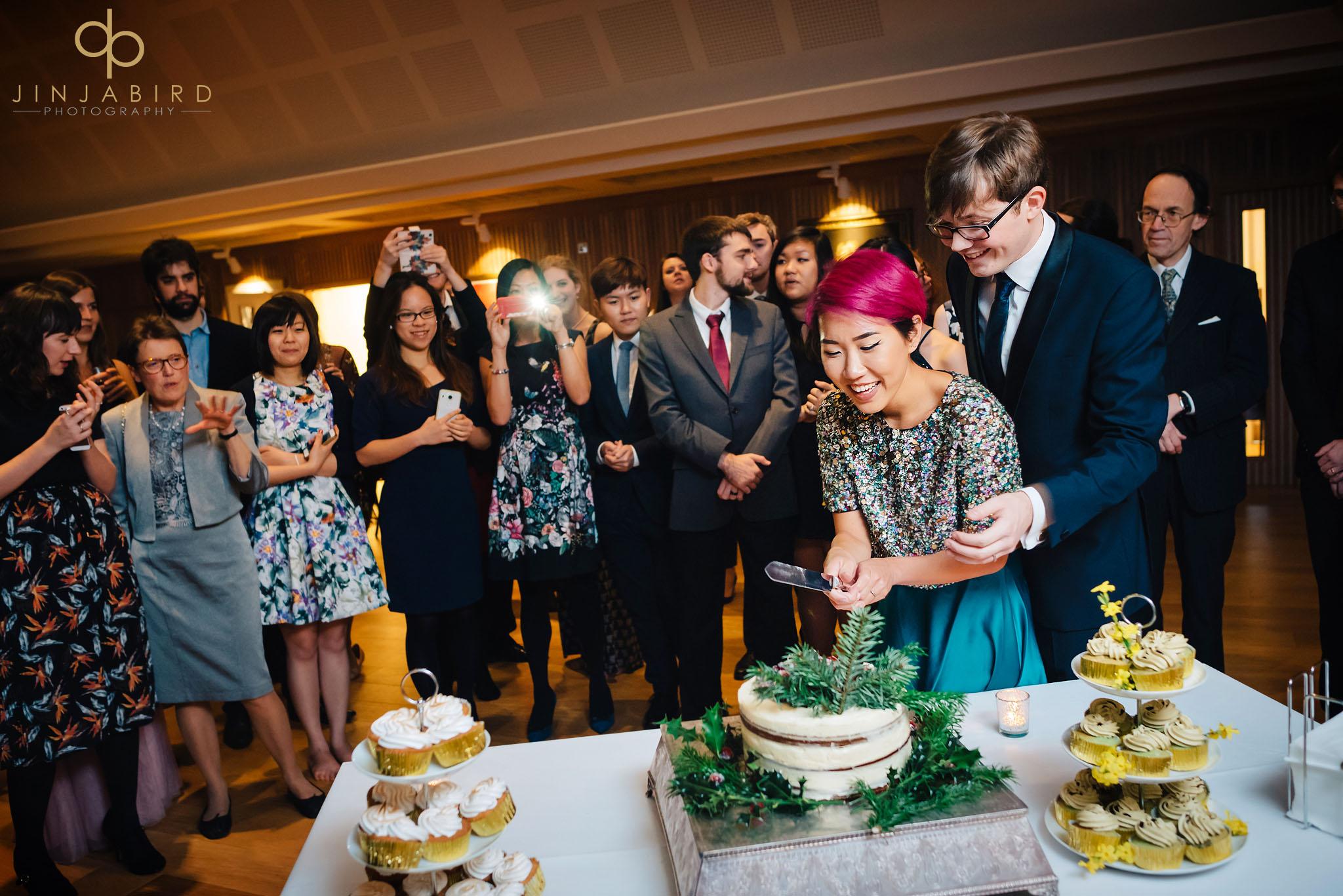 cutting-wedding-cake-leckhampton-house-cambridge
