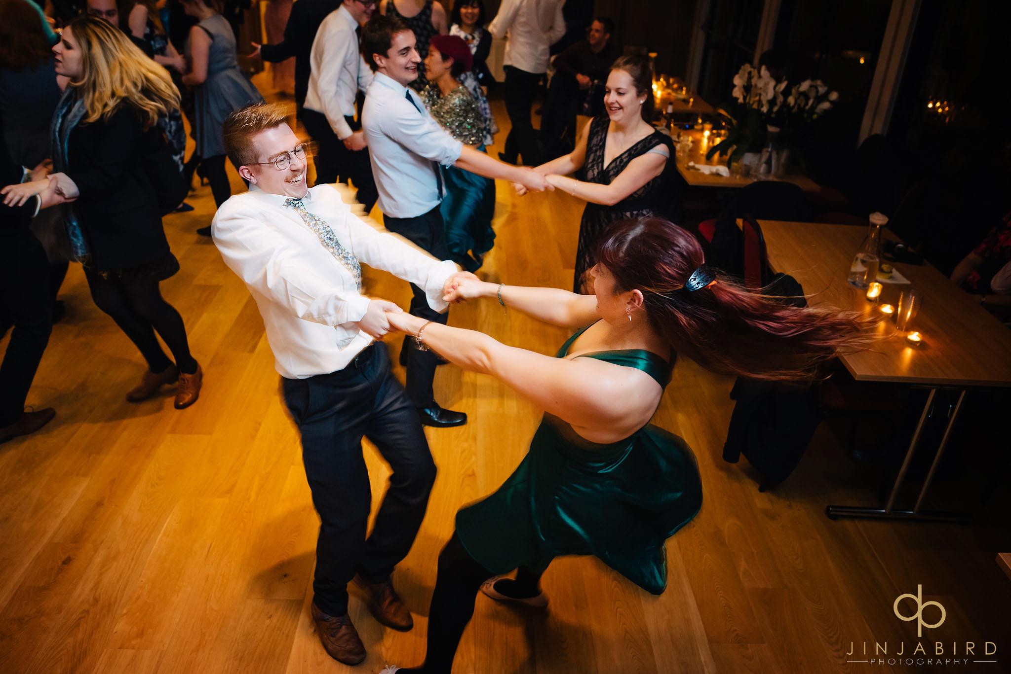 wedding-guests-dancing-leckhampton-house-cambridge