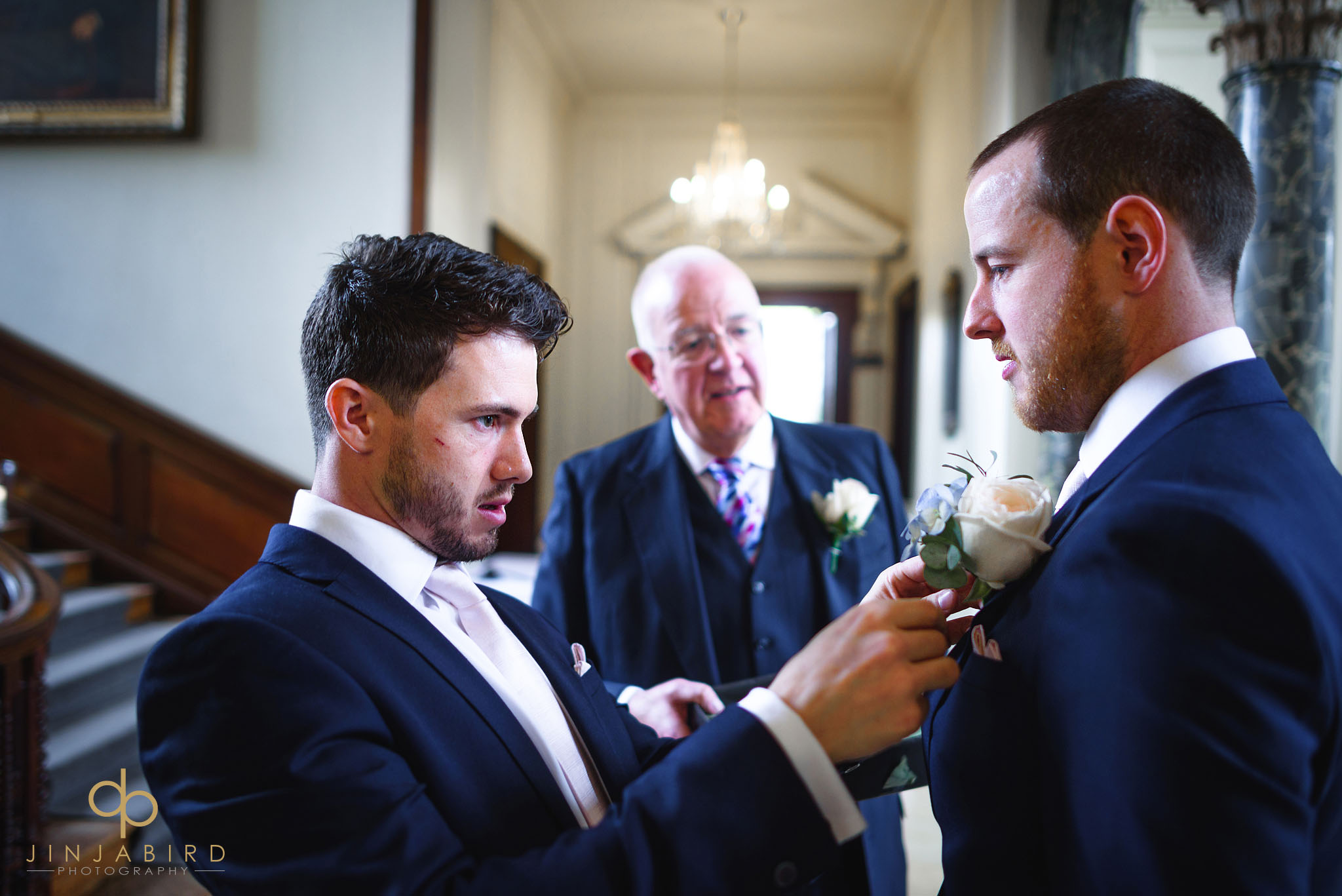 bestman puts in grooms button hole chicheley hall