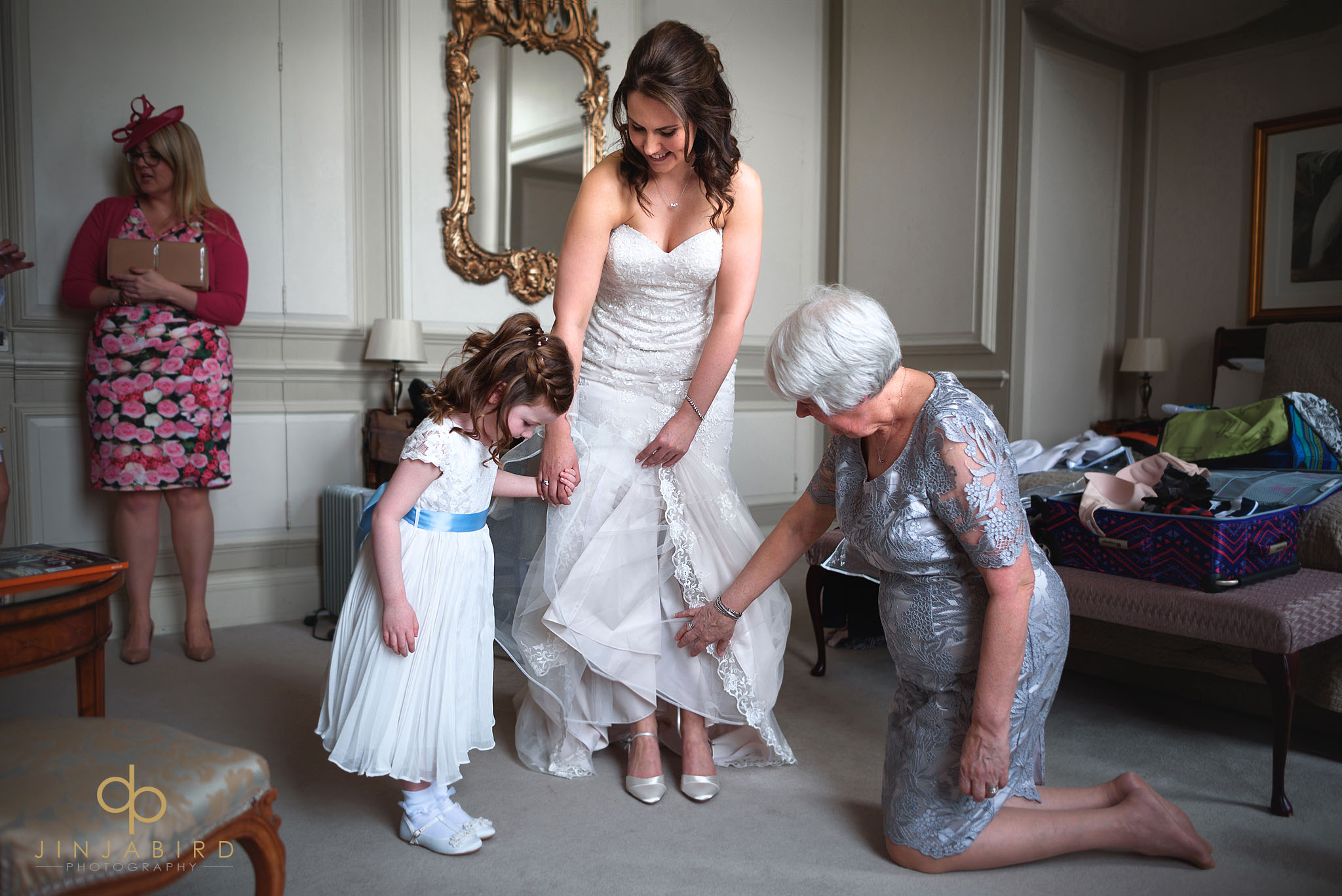 bride putting on shoes chicheley hall