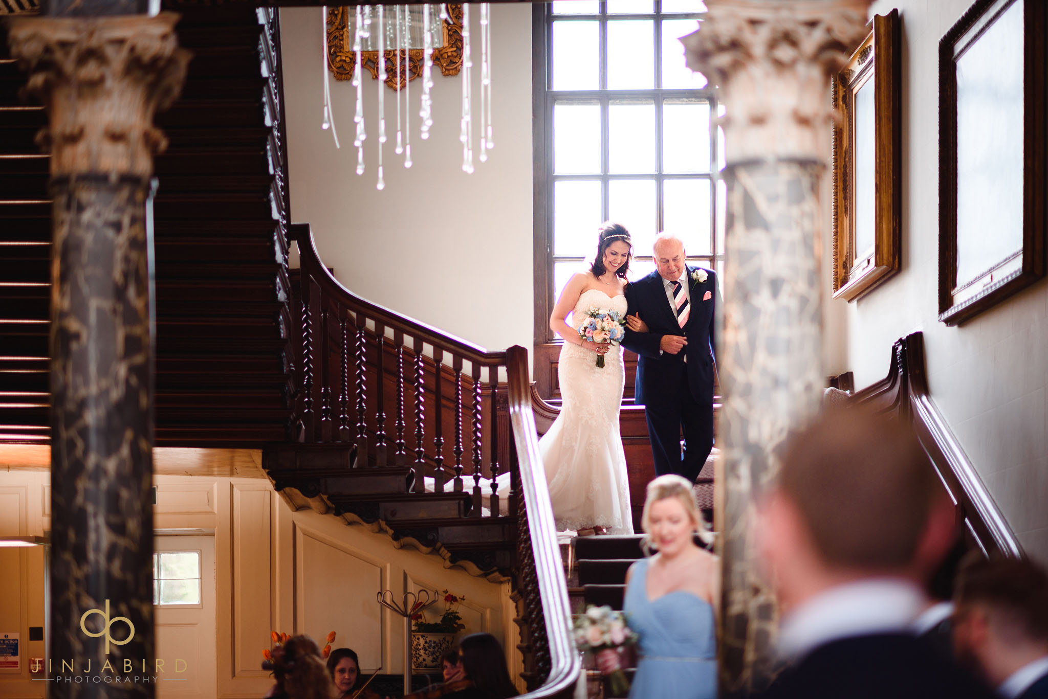 bride coming down stairs with father chicheley hall