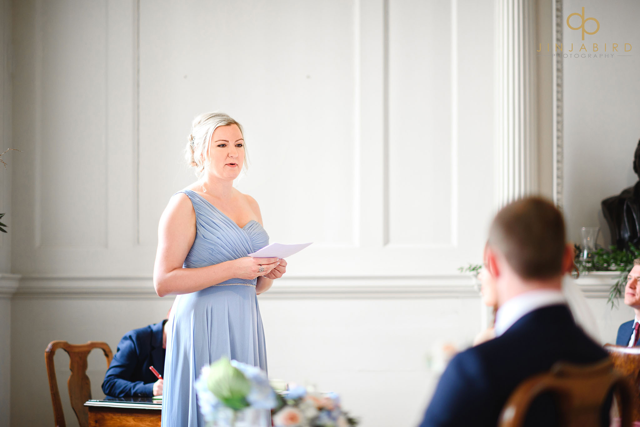 bridesmaid reading during wedding ceremony chicheley hall