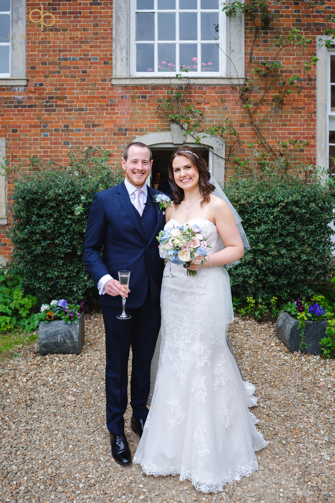 groom with bride outside chicheley hall