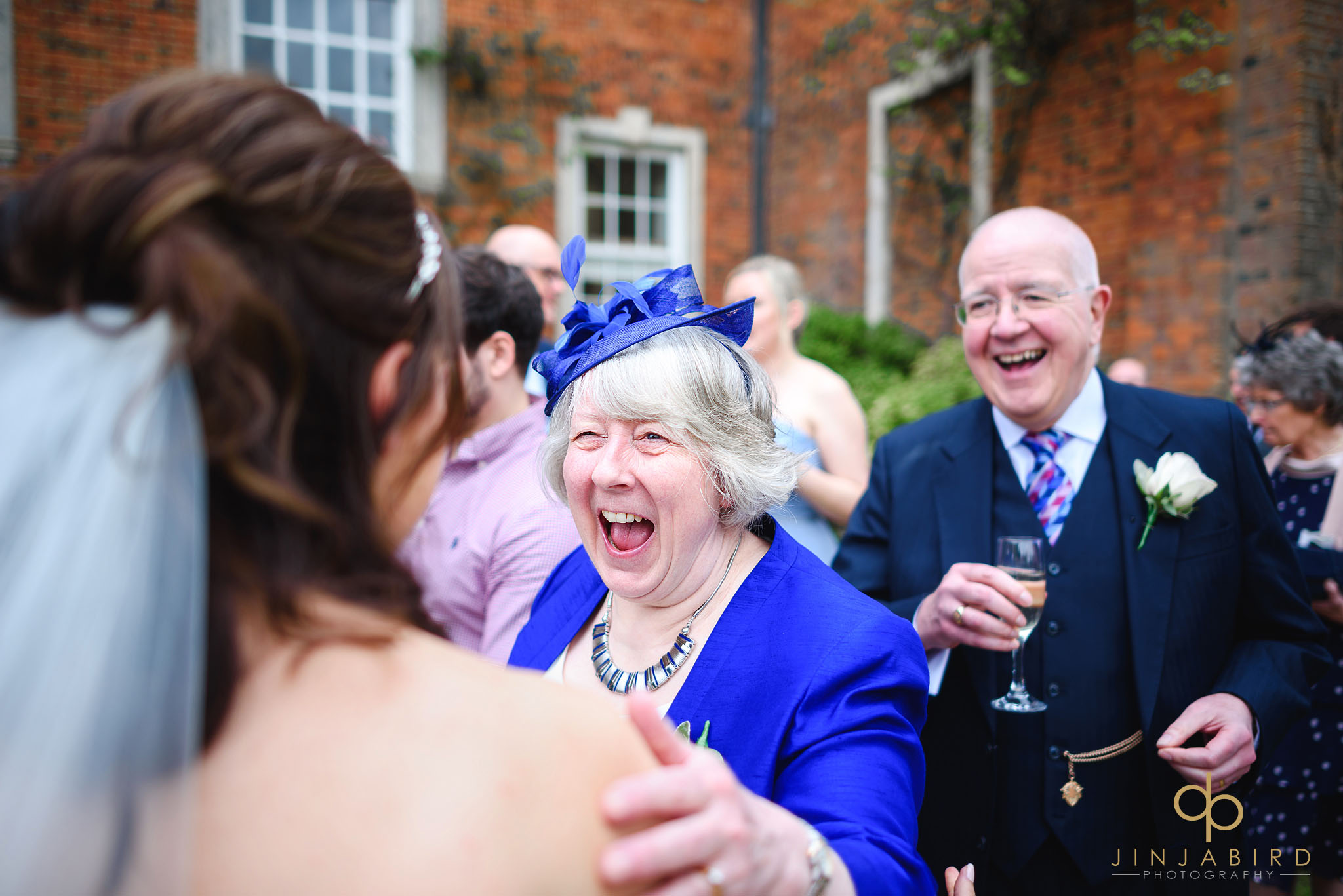 grooms mum talking with bride chicheley hall