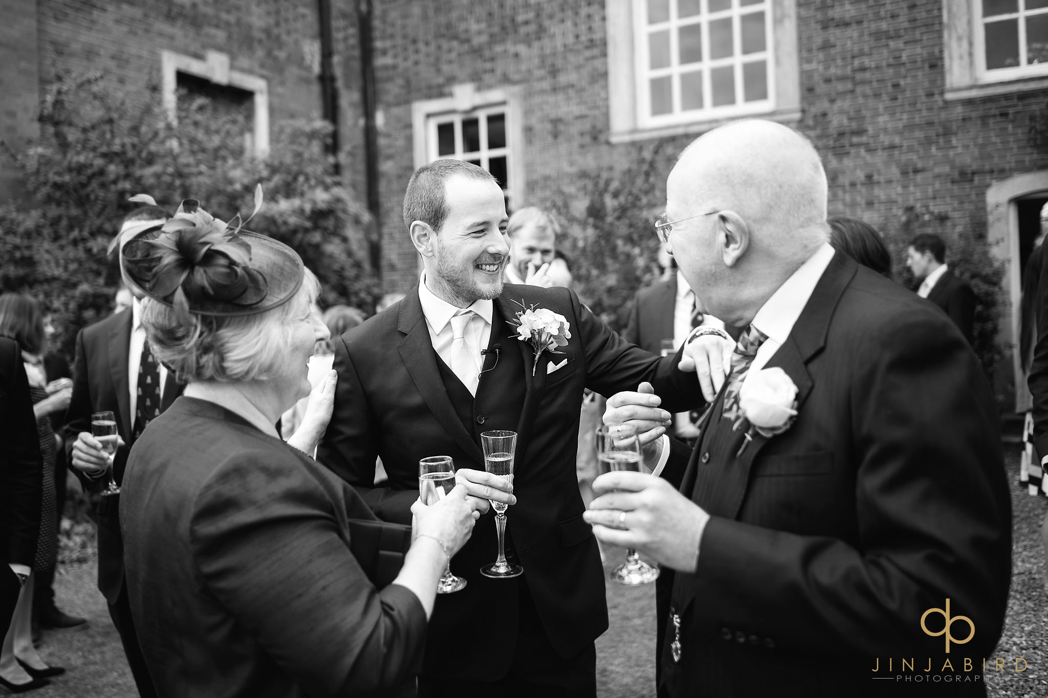 groom talking to father chicheley hall