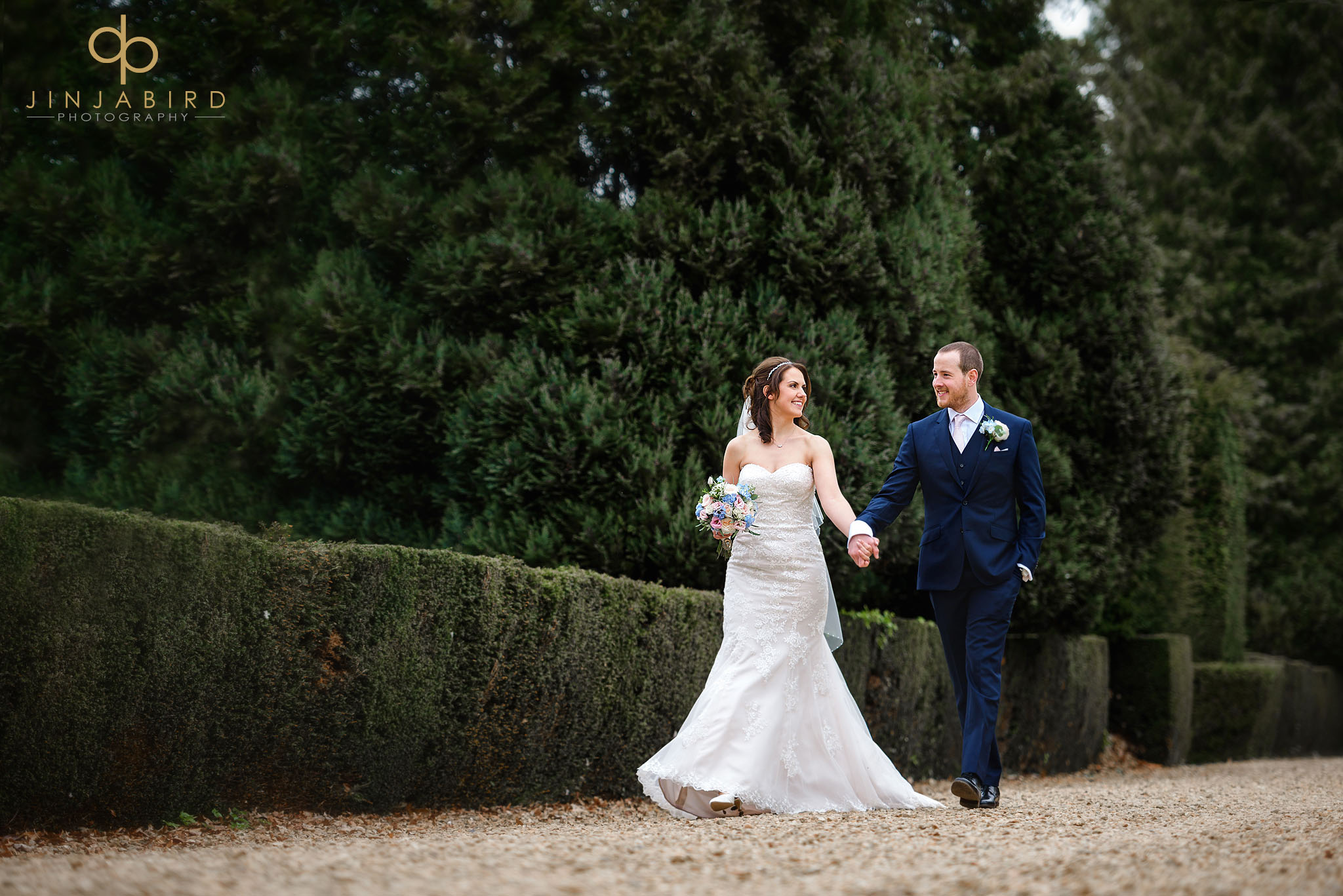 bride and groom walking chicheley hall