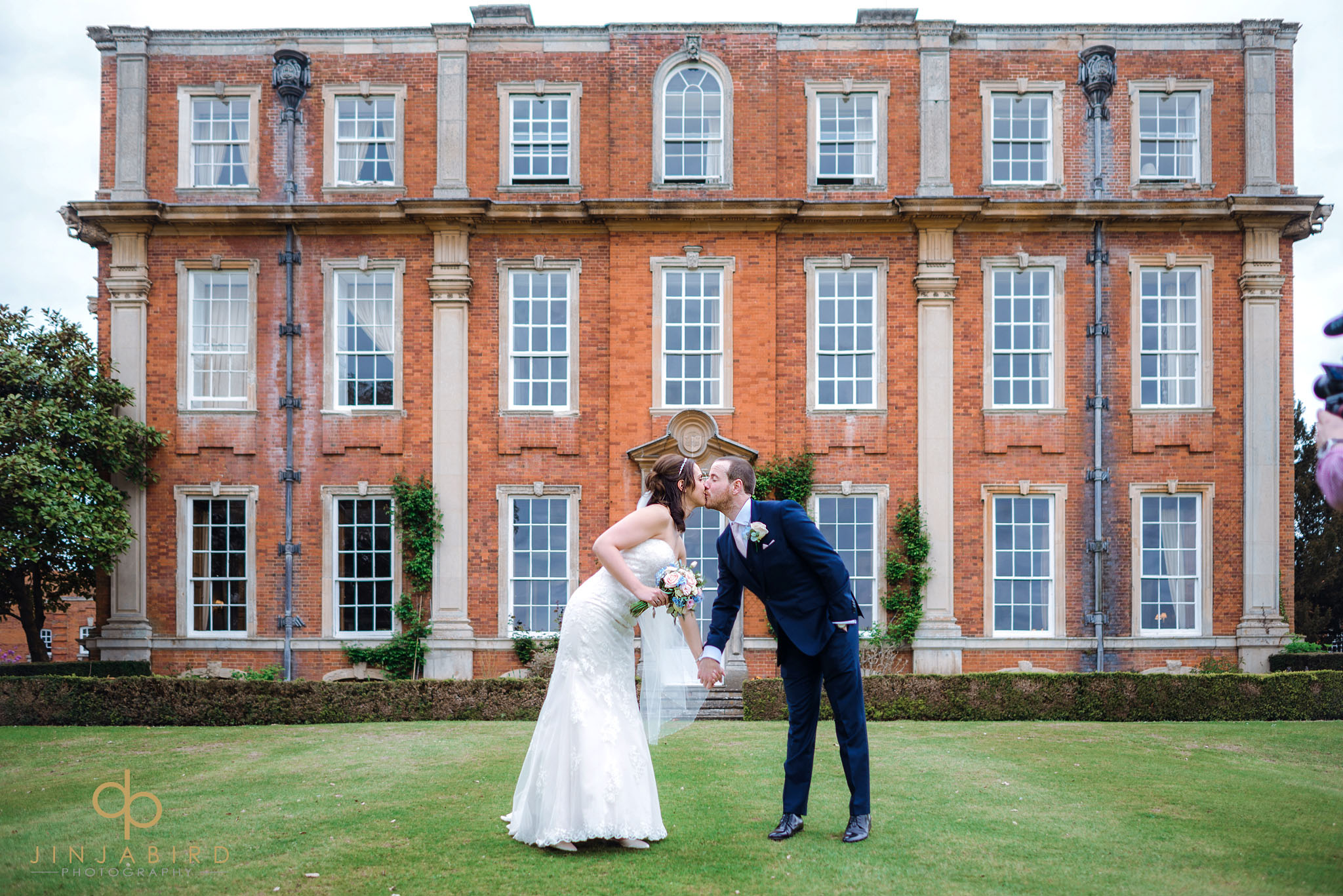 bride and groom kissing chicheley hall