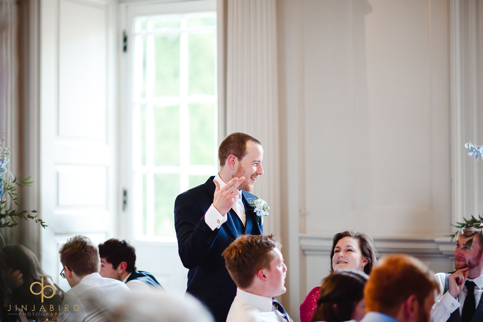 groom talking at dinner chicheley hall