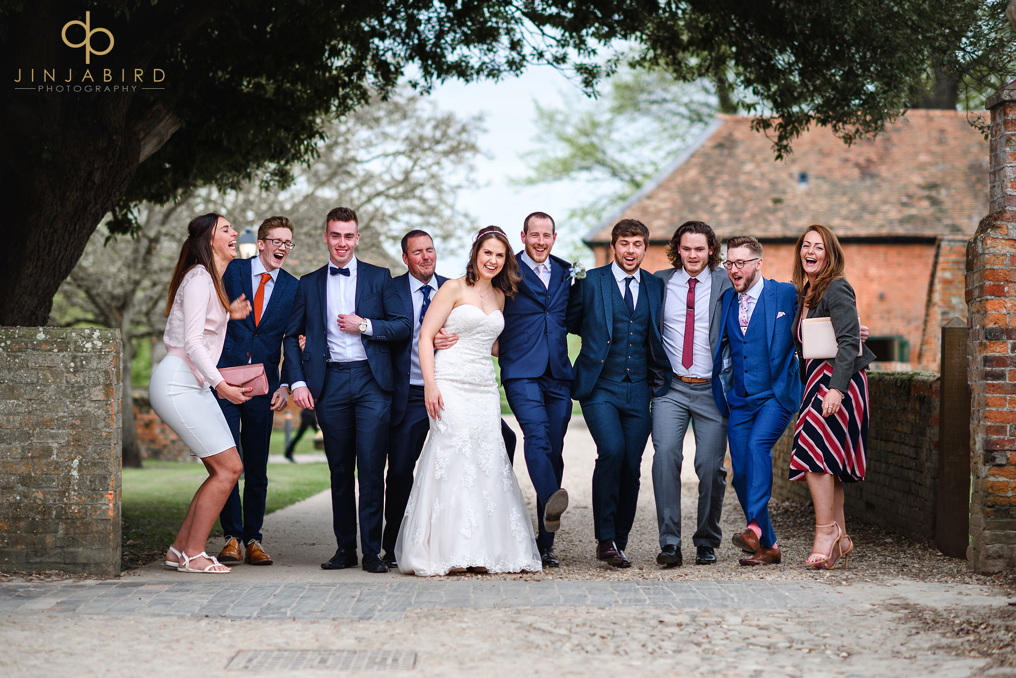 bride and groom with friends chicheley hall