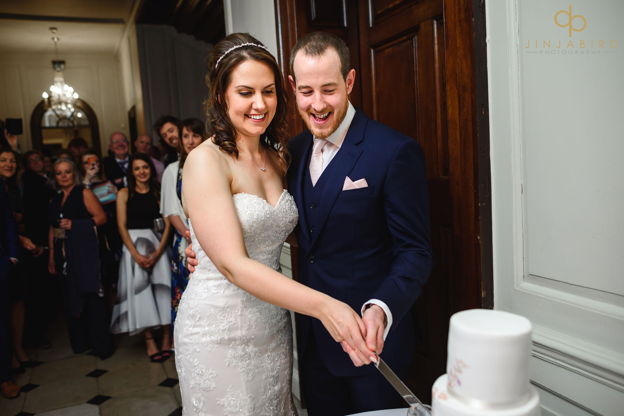 bride and groom cutting wedding cake chicheley hall
