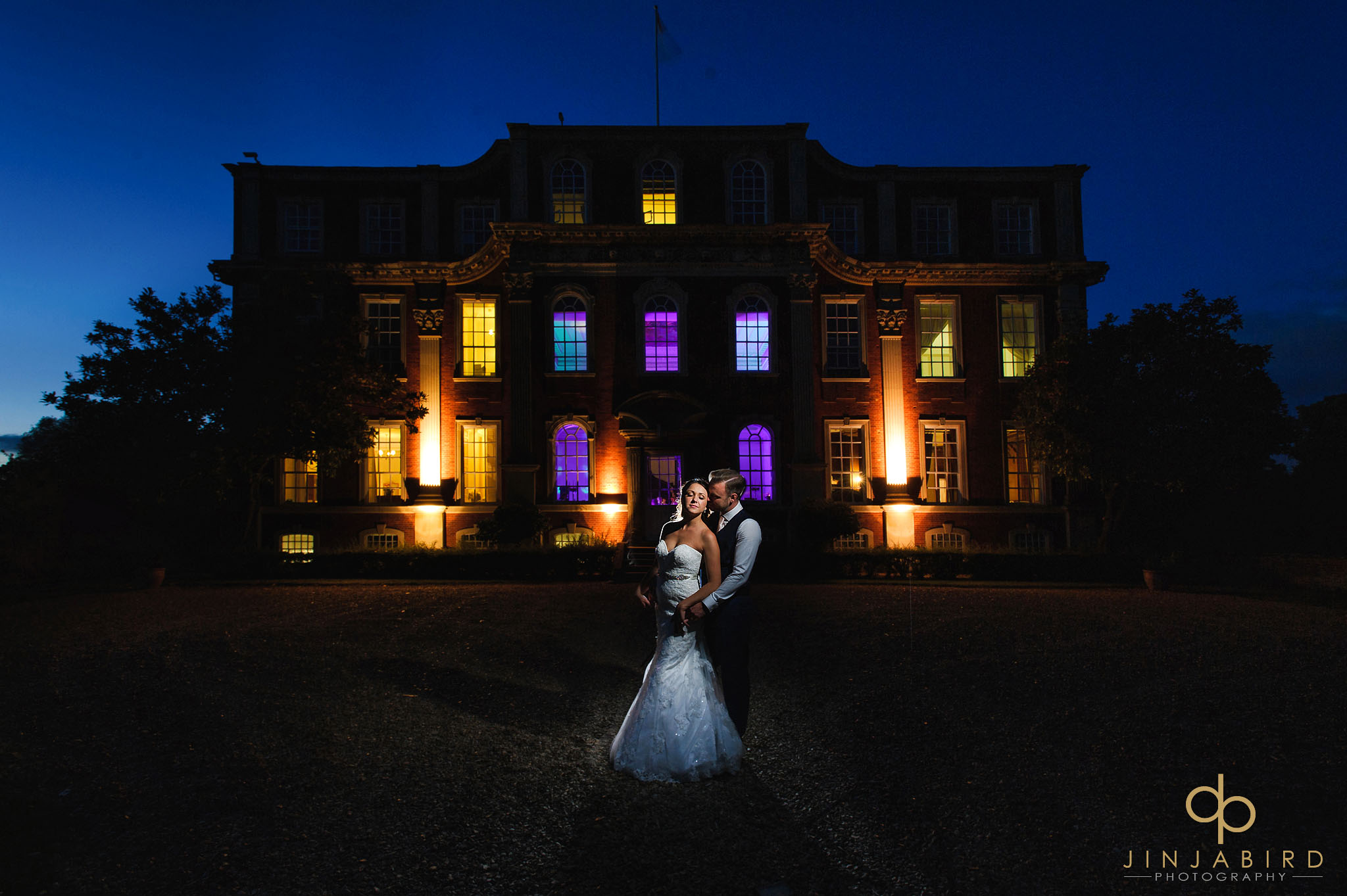 bride groom outside chicheley hall at night