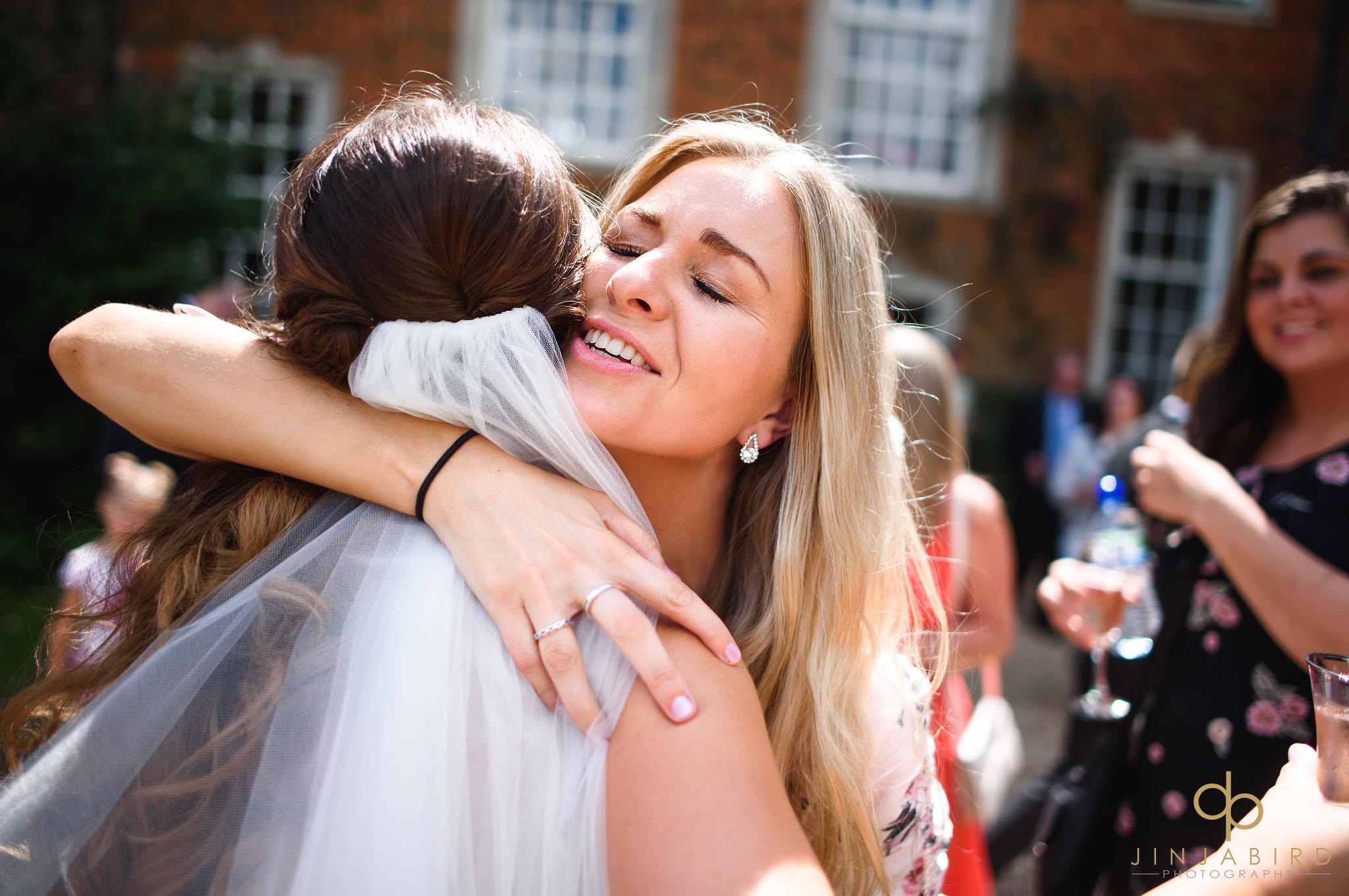 bride huggs guest