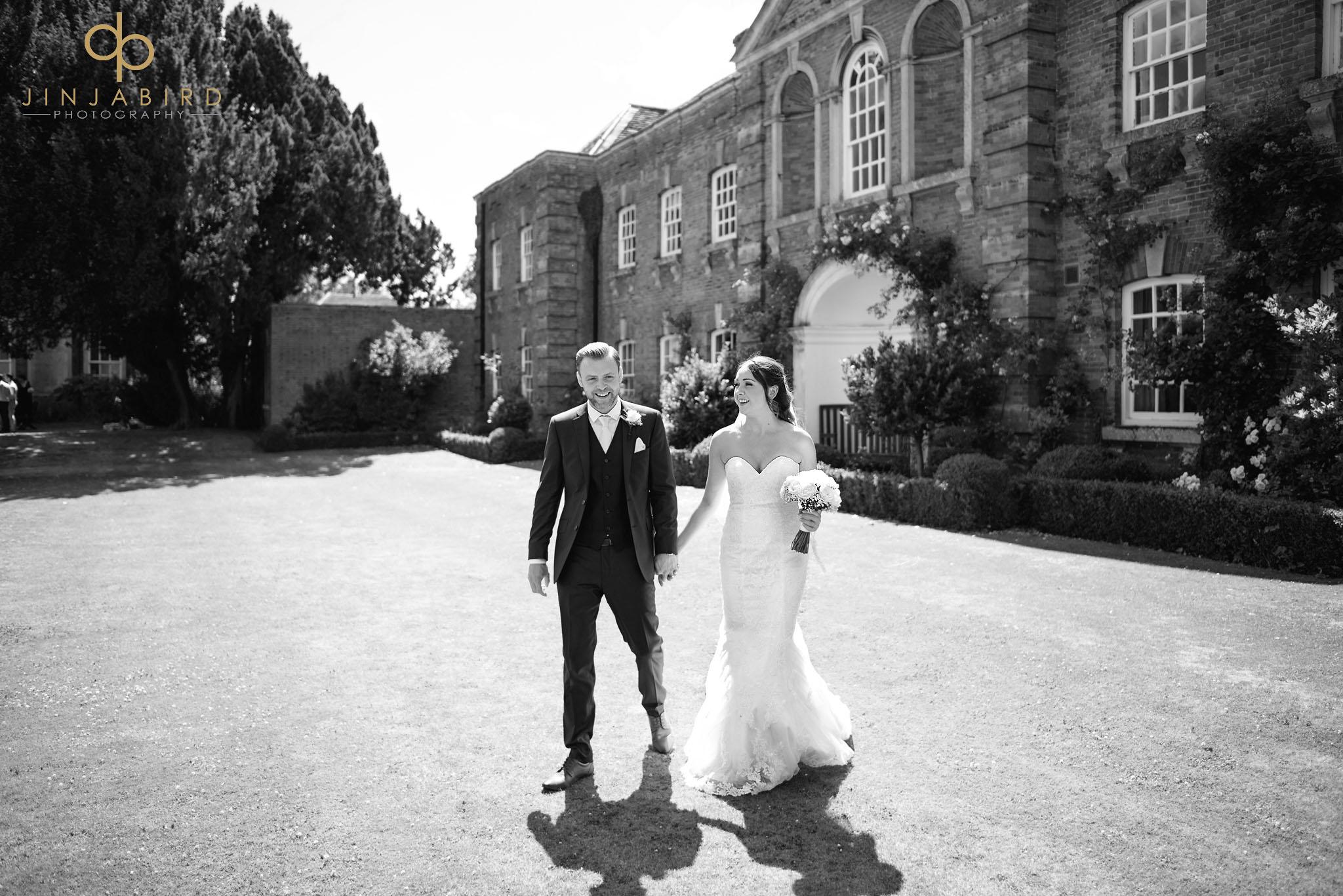 bride with groom in garden chicheley hall