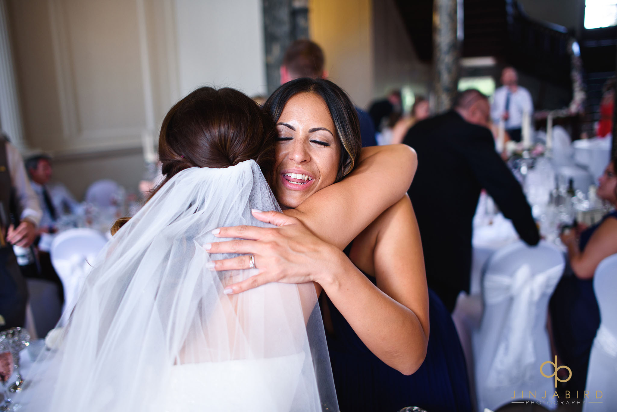 bridesmaid huggs bride