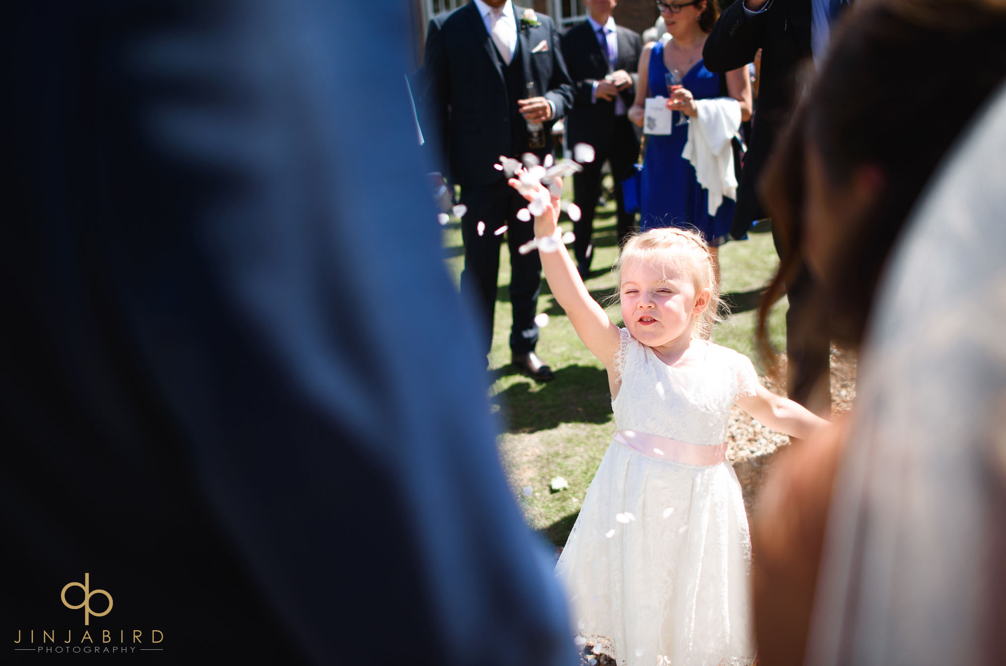 flowergirl throwing confetti chicheley hall