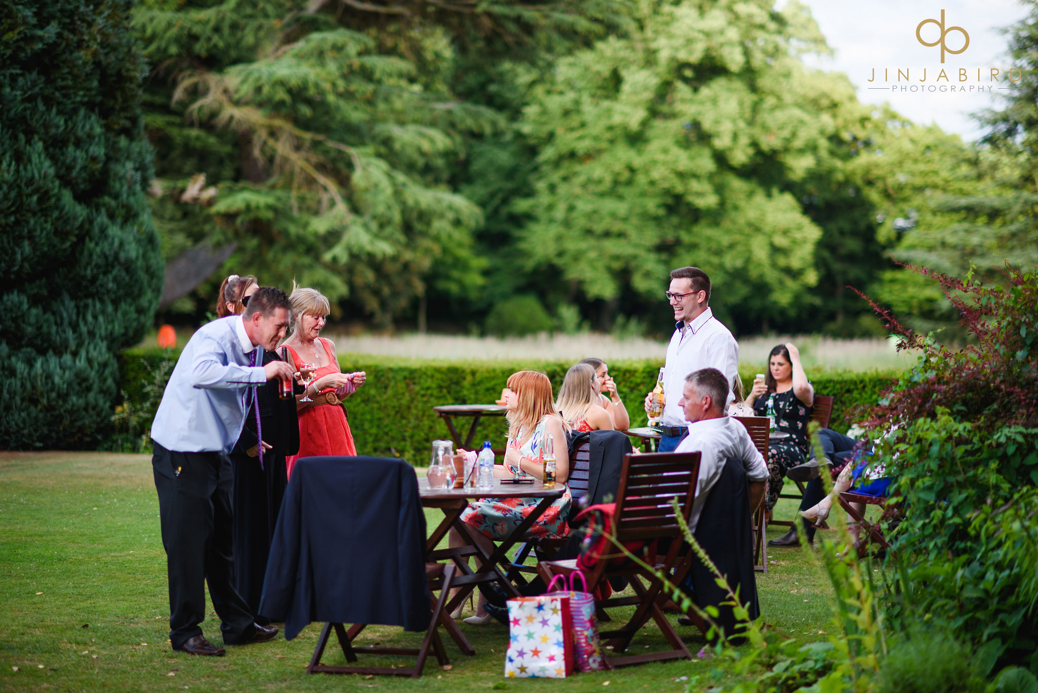 wedding guests in garden chicheley hall