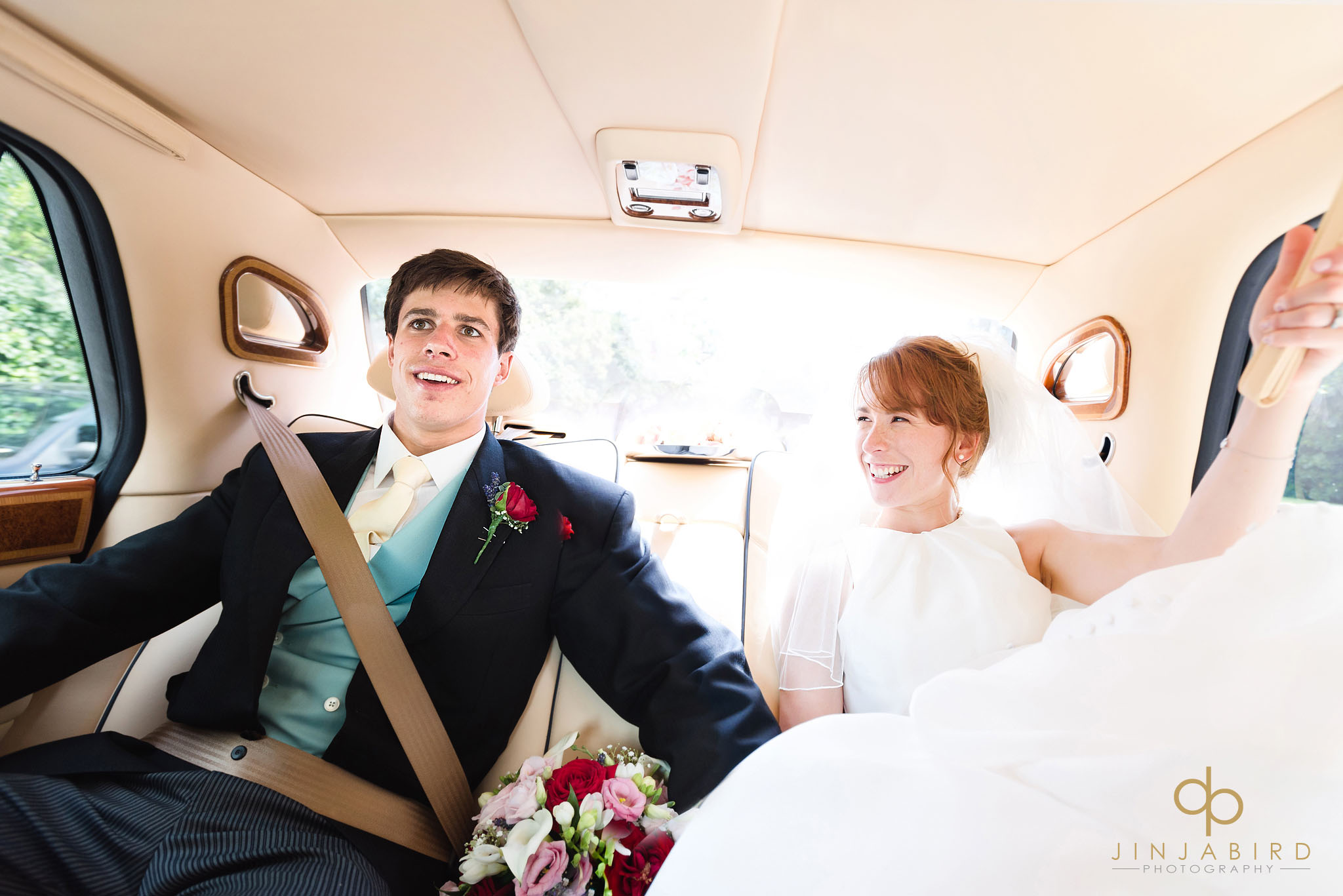 bride with groom in car