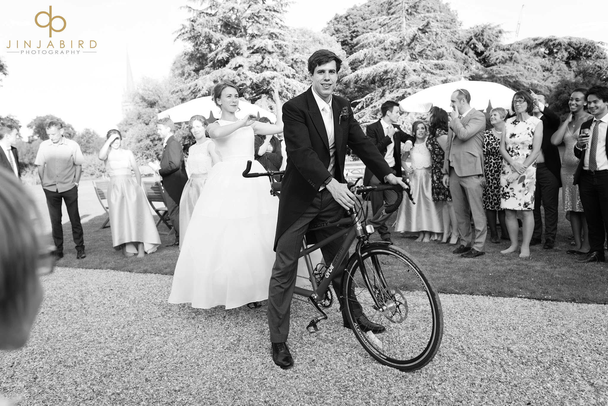 bride with groom on tandem downing college