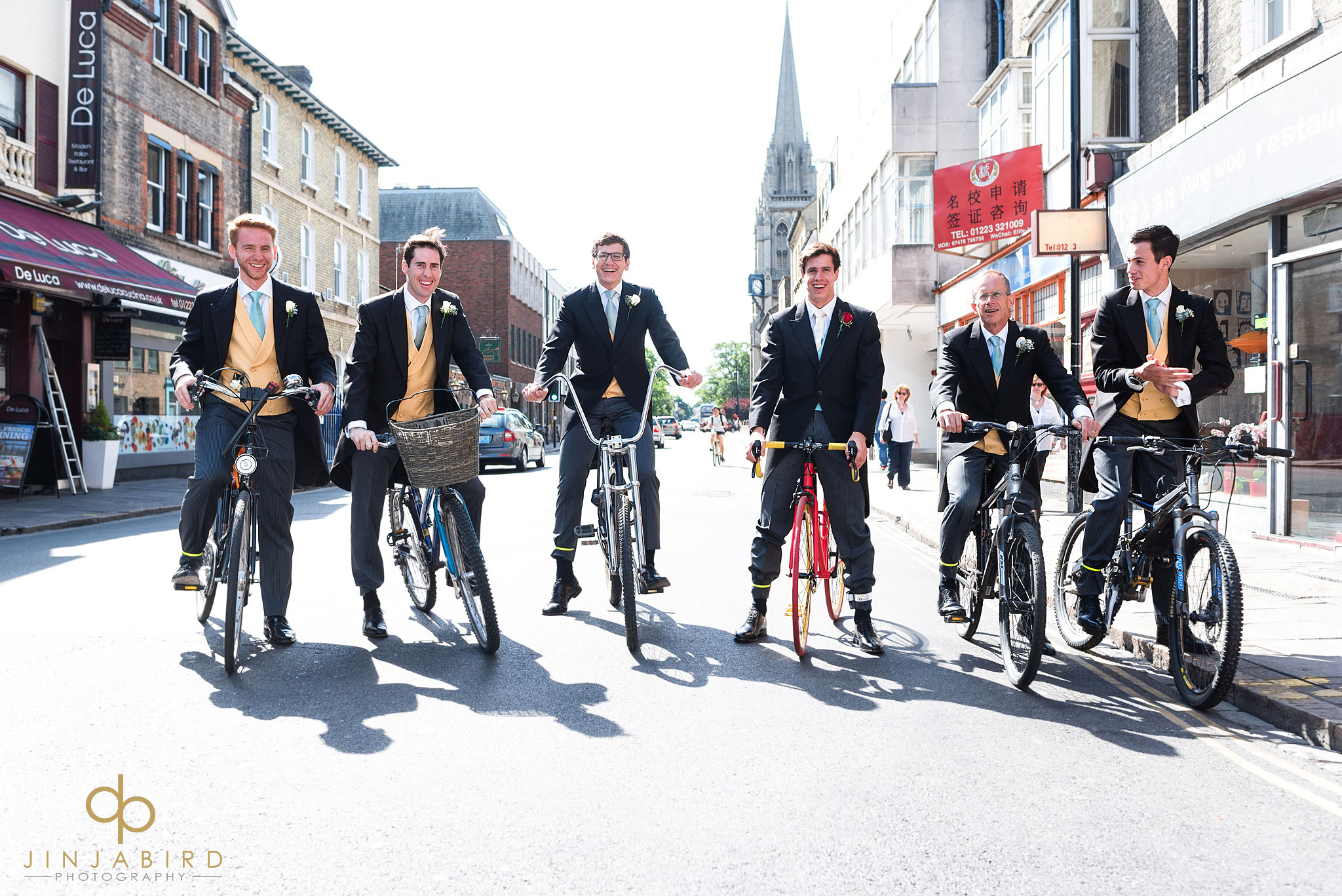 groom with ushers on bikes cambridge