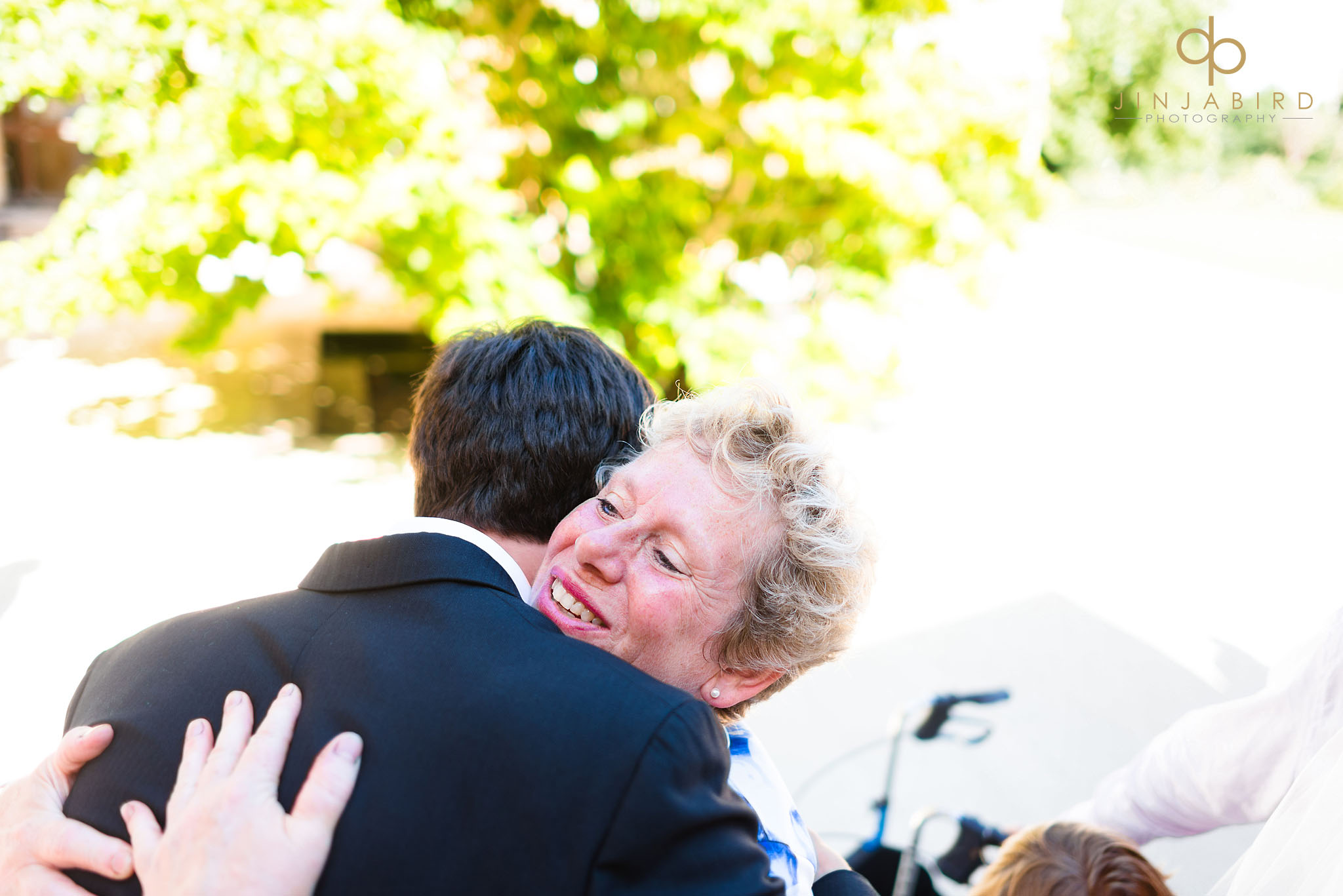 guest hugging groom downing college